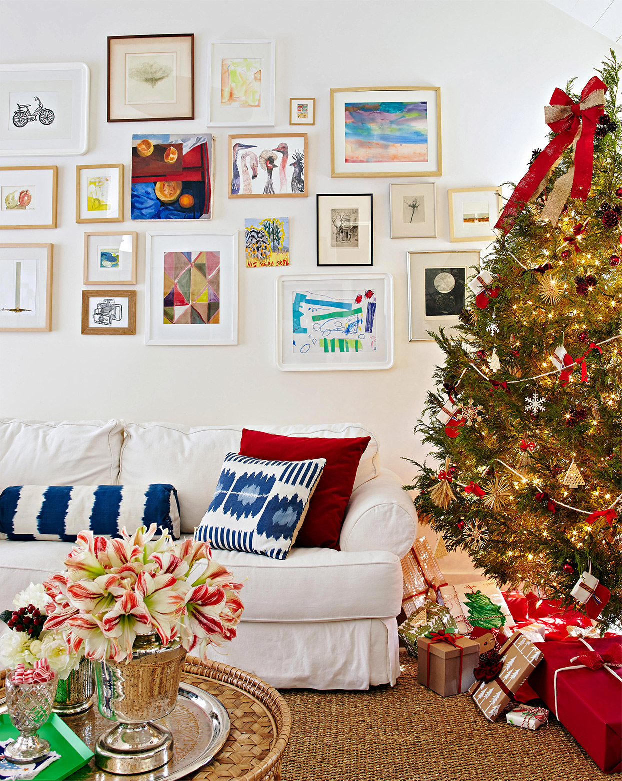 white slipcovered sofa under eclectic gallery wall near decorated Christmas tree
