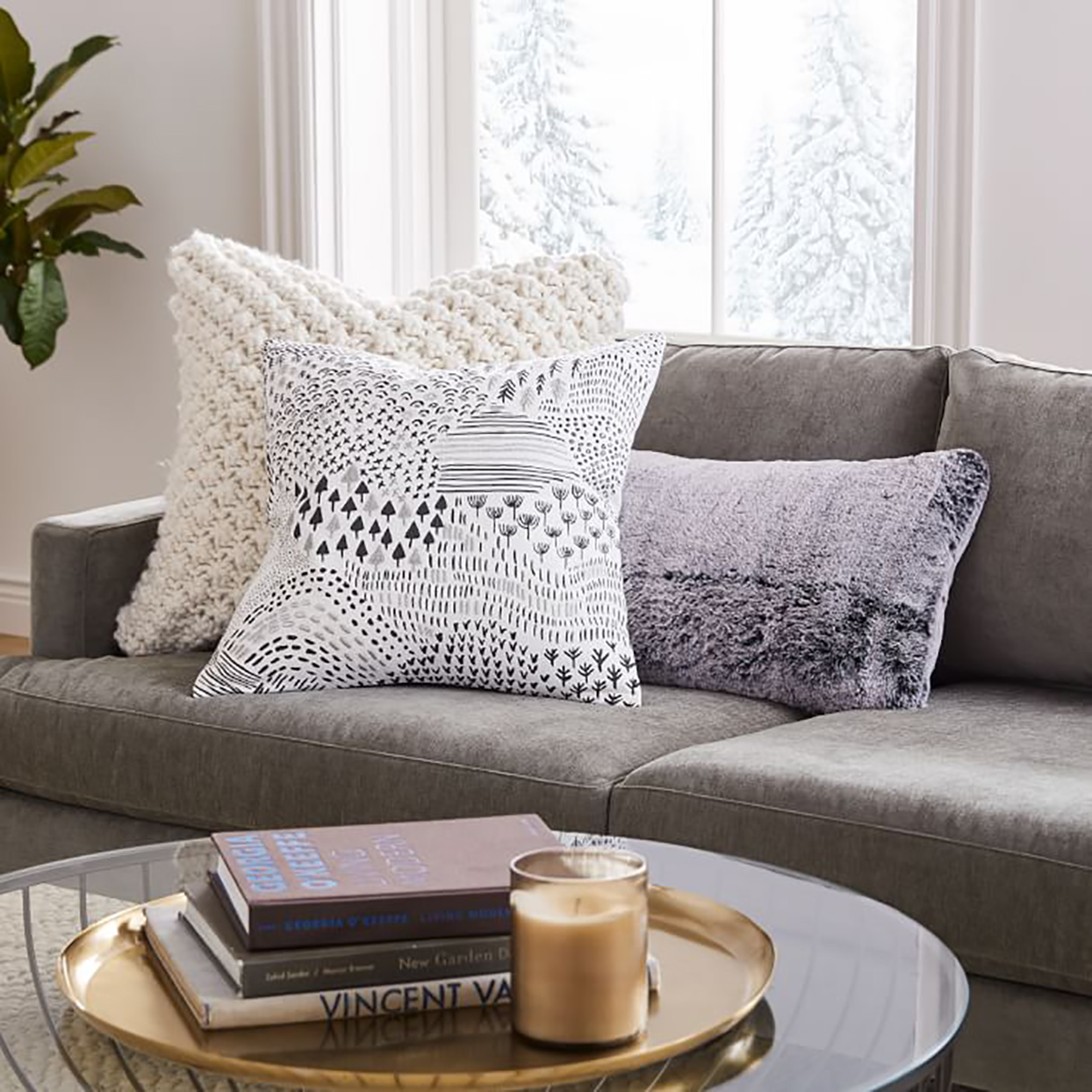 gray sofa with patterned pillows
