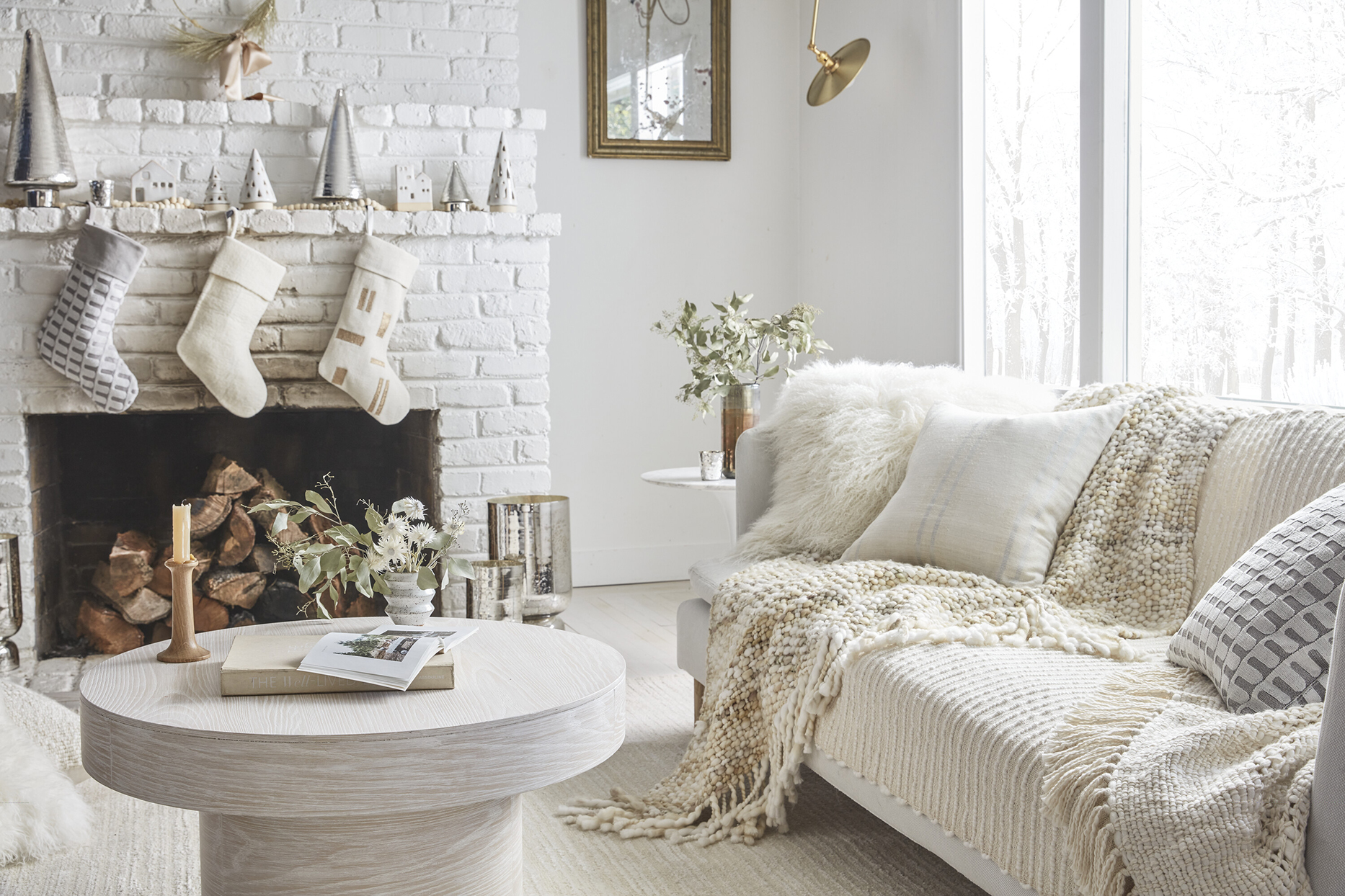 white living room with cozy holiday decor