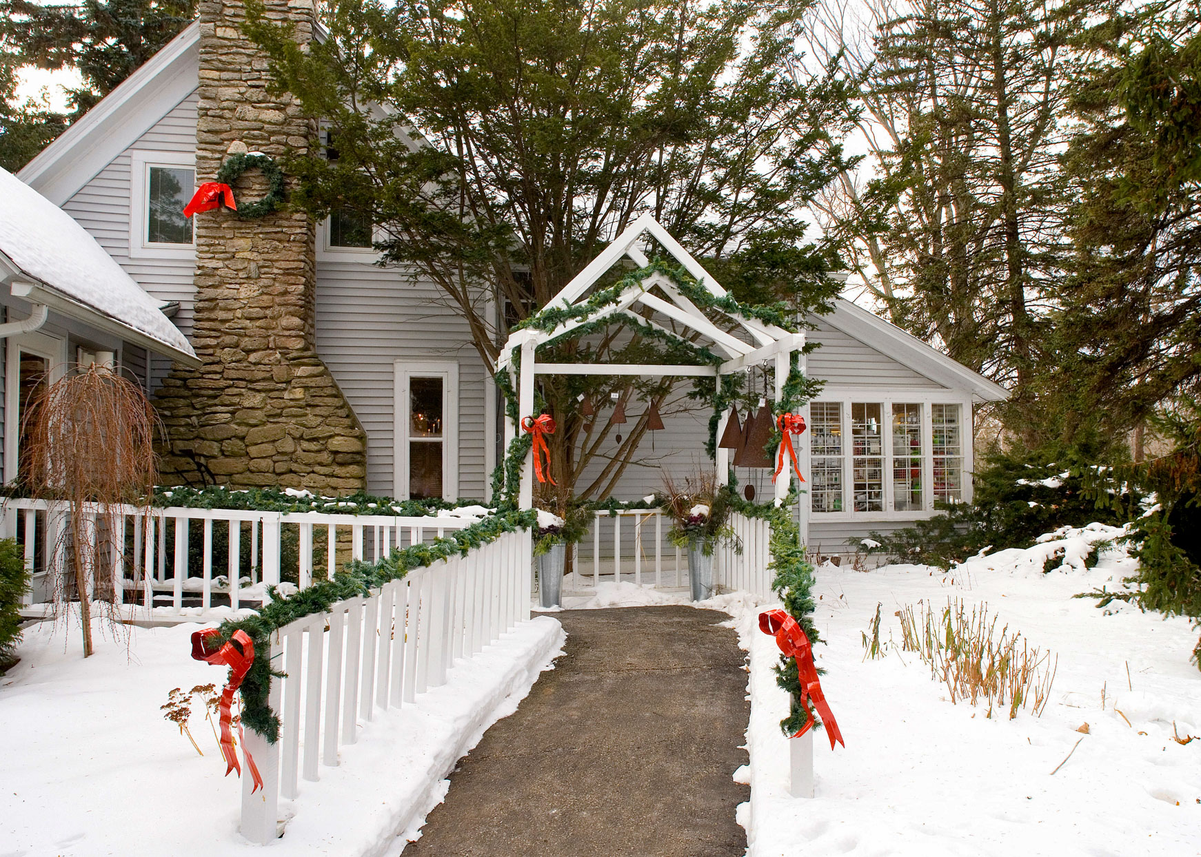 home walkway decorated with garland in snow