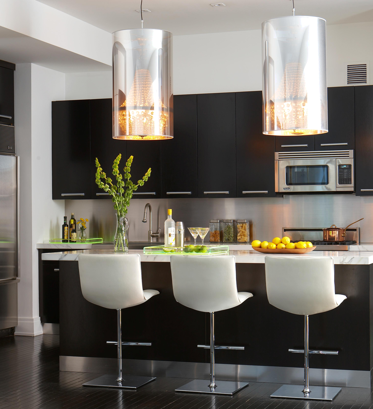 kitchen island seating with large lights above