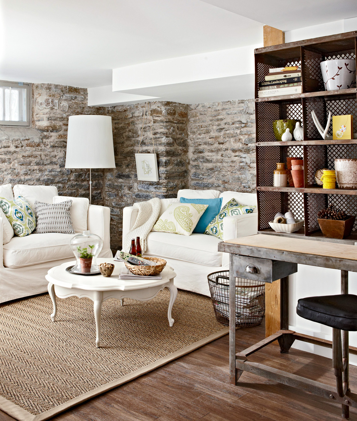neutral tones family room with stone walls
