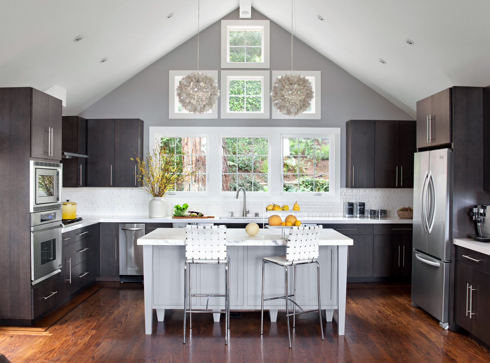 open kitchen with island and wood cabinets