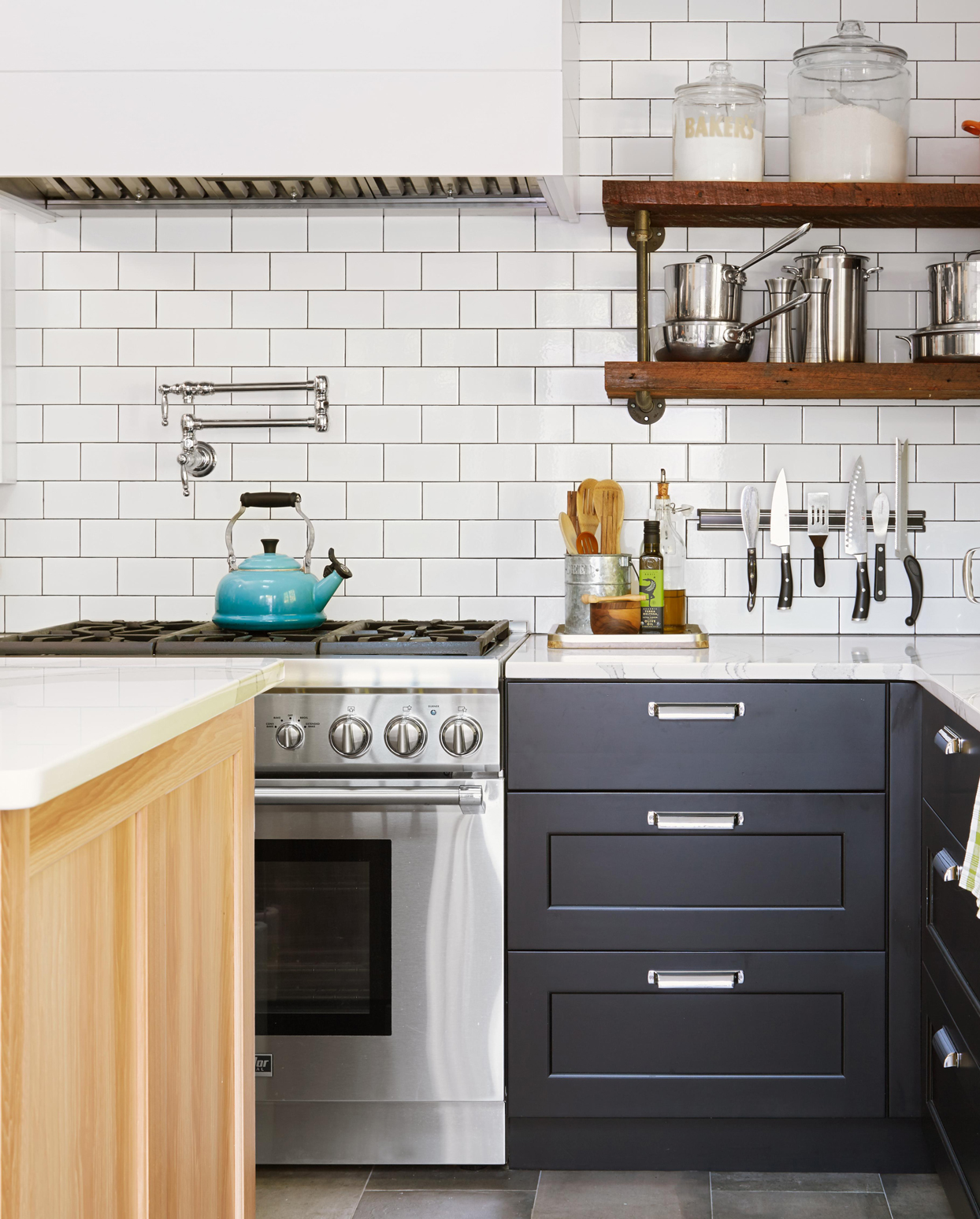 white subway tile backsplash and pot filler