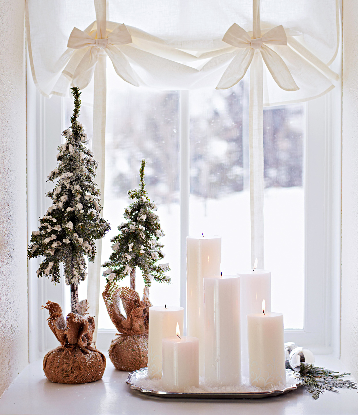 candles and mini trees in front of window