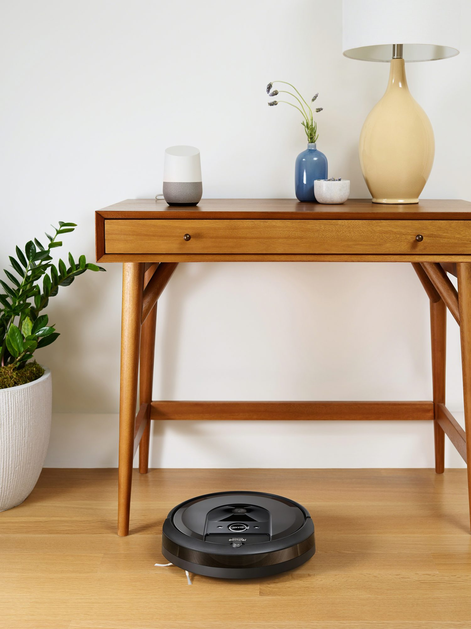 irobot roomba smart vacuum on hardwood floor