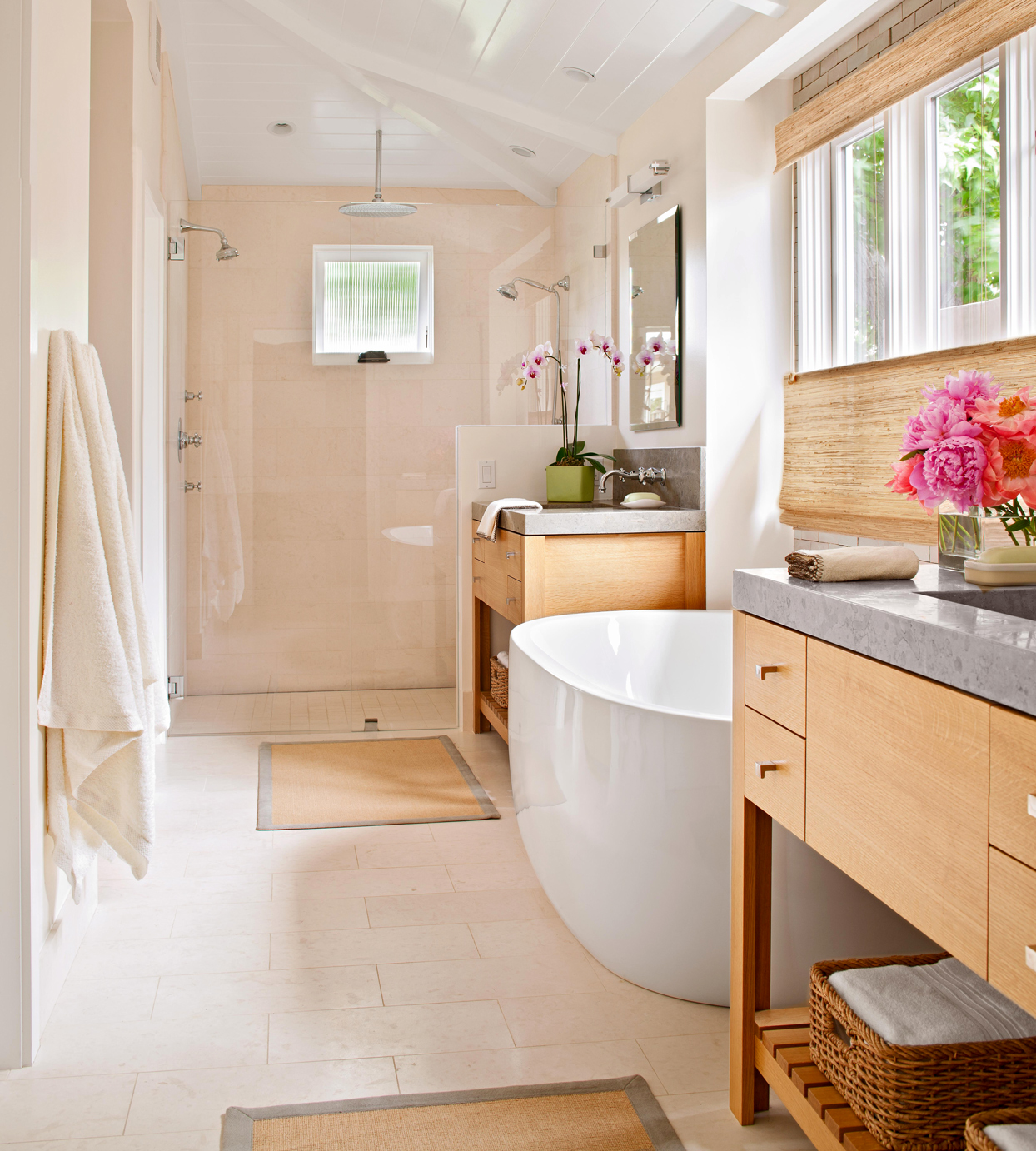 bathroom with multiple shower heads and tub