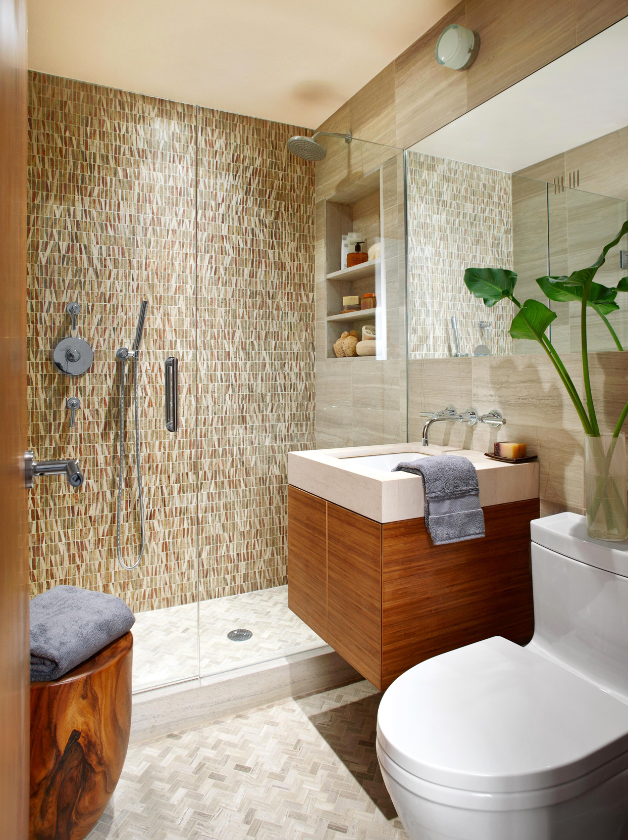 bathroom with stone mosaic shower