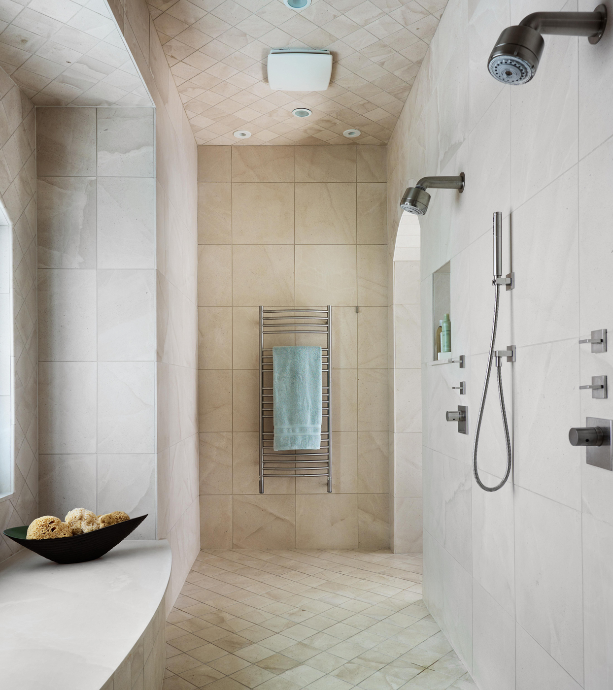 shower with two shower heads and towel rack