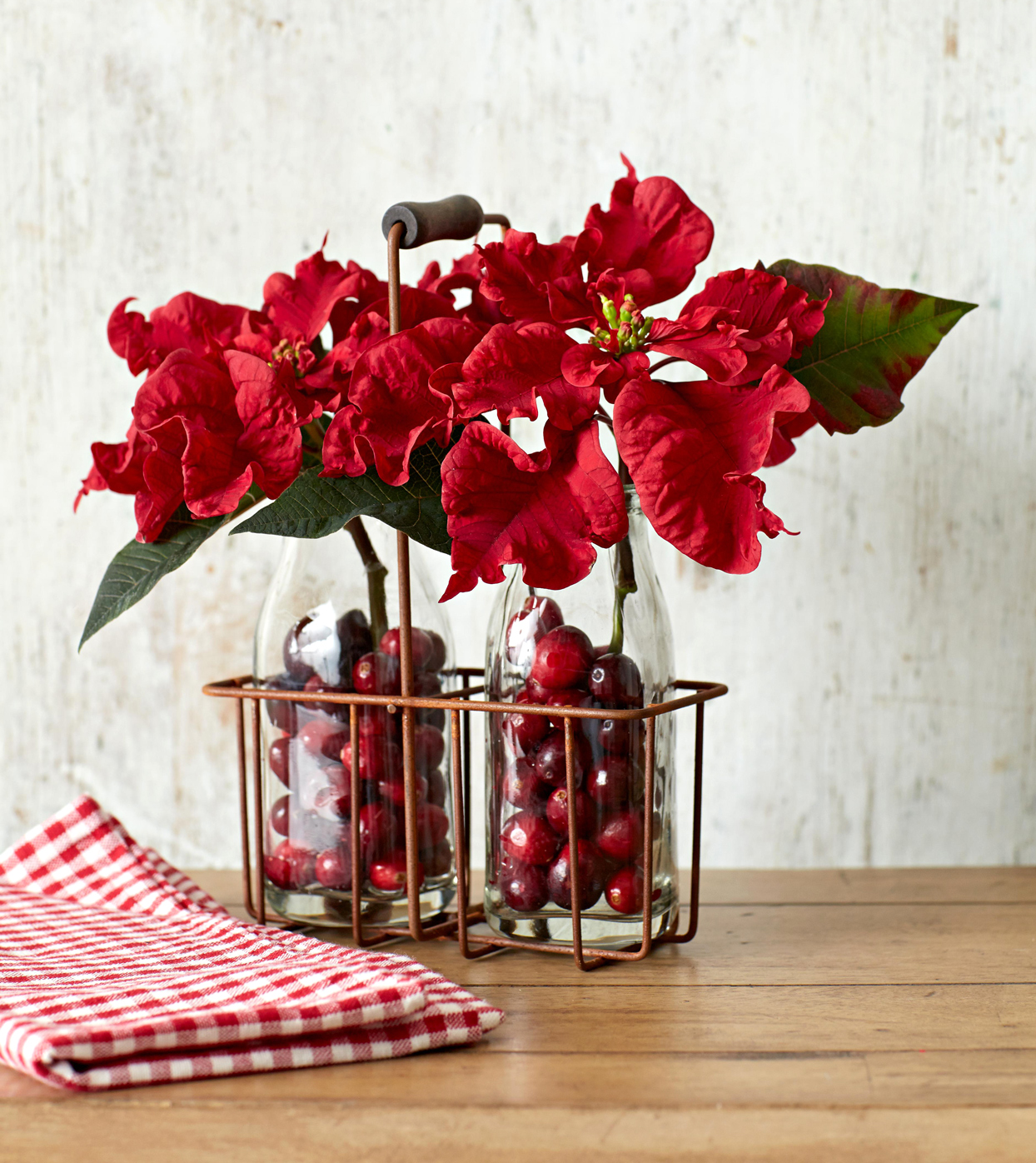 Cranberry-Filled Poinsettia Jars