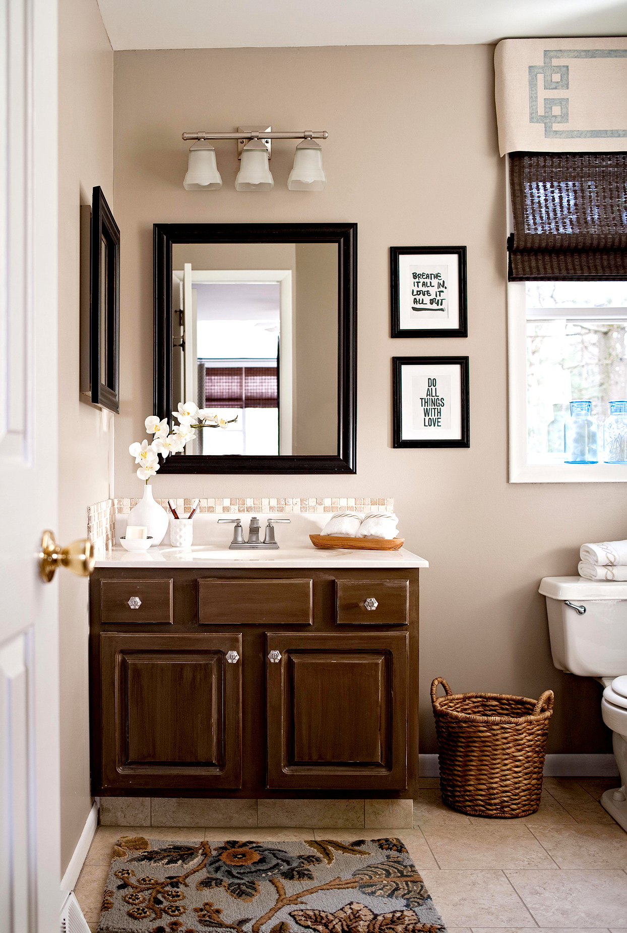 traditional style bathroom with beige and blue color scheme