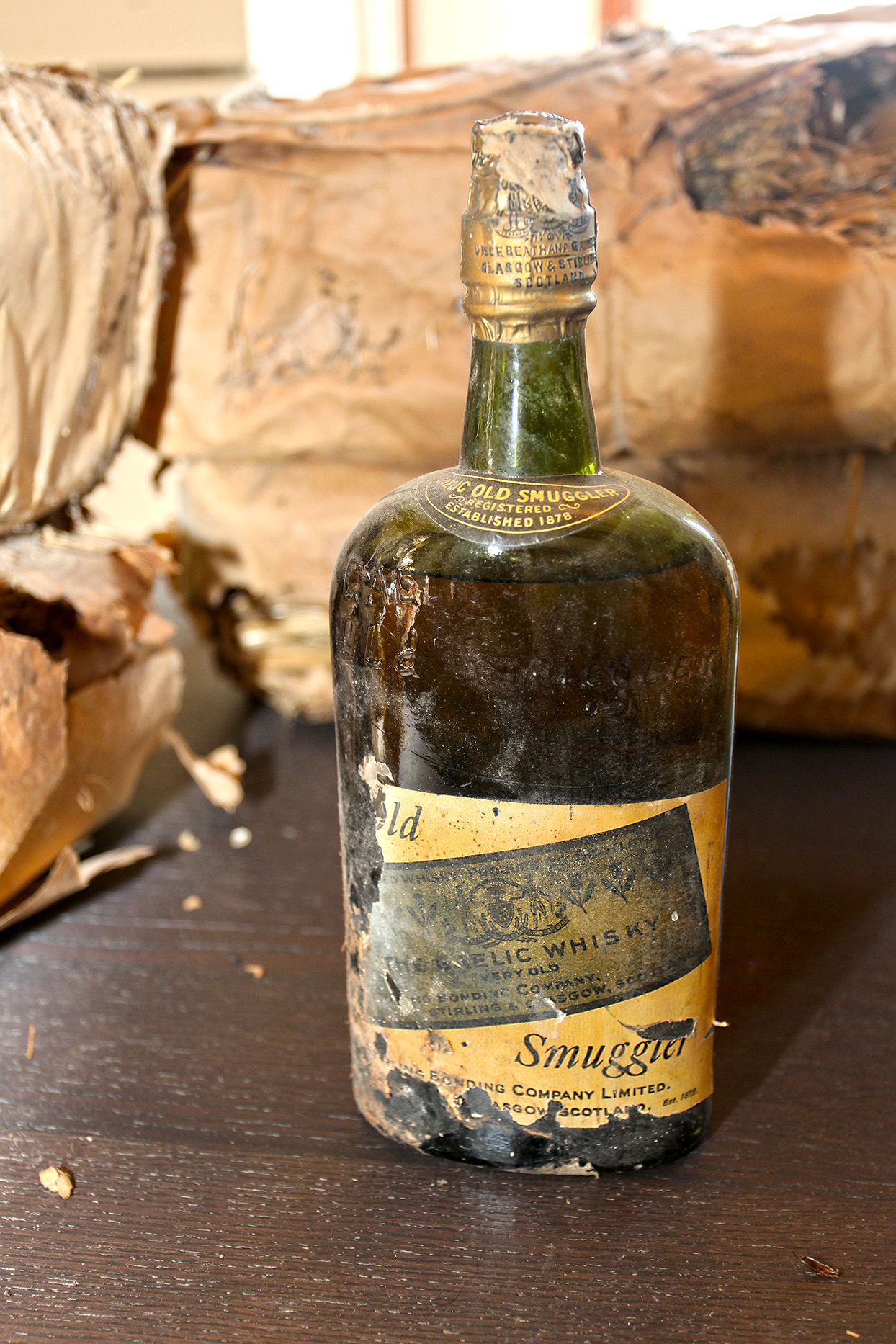 century-old imported Old Smuggler Gaelic Whiskey bottle found in prohibition-era home