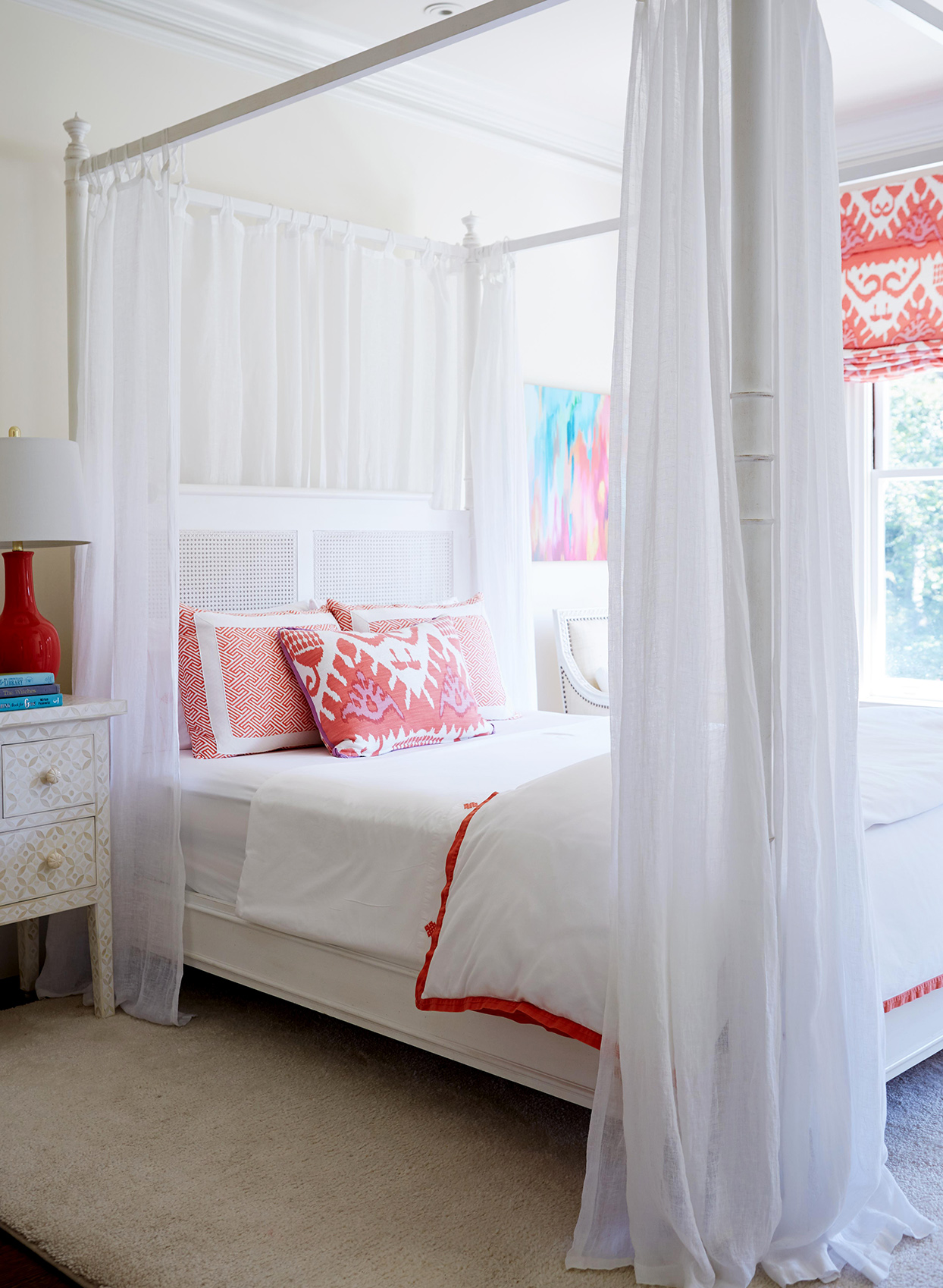 White bedroom with sheer curtains