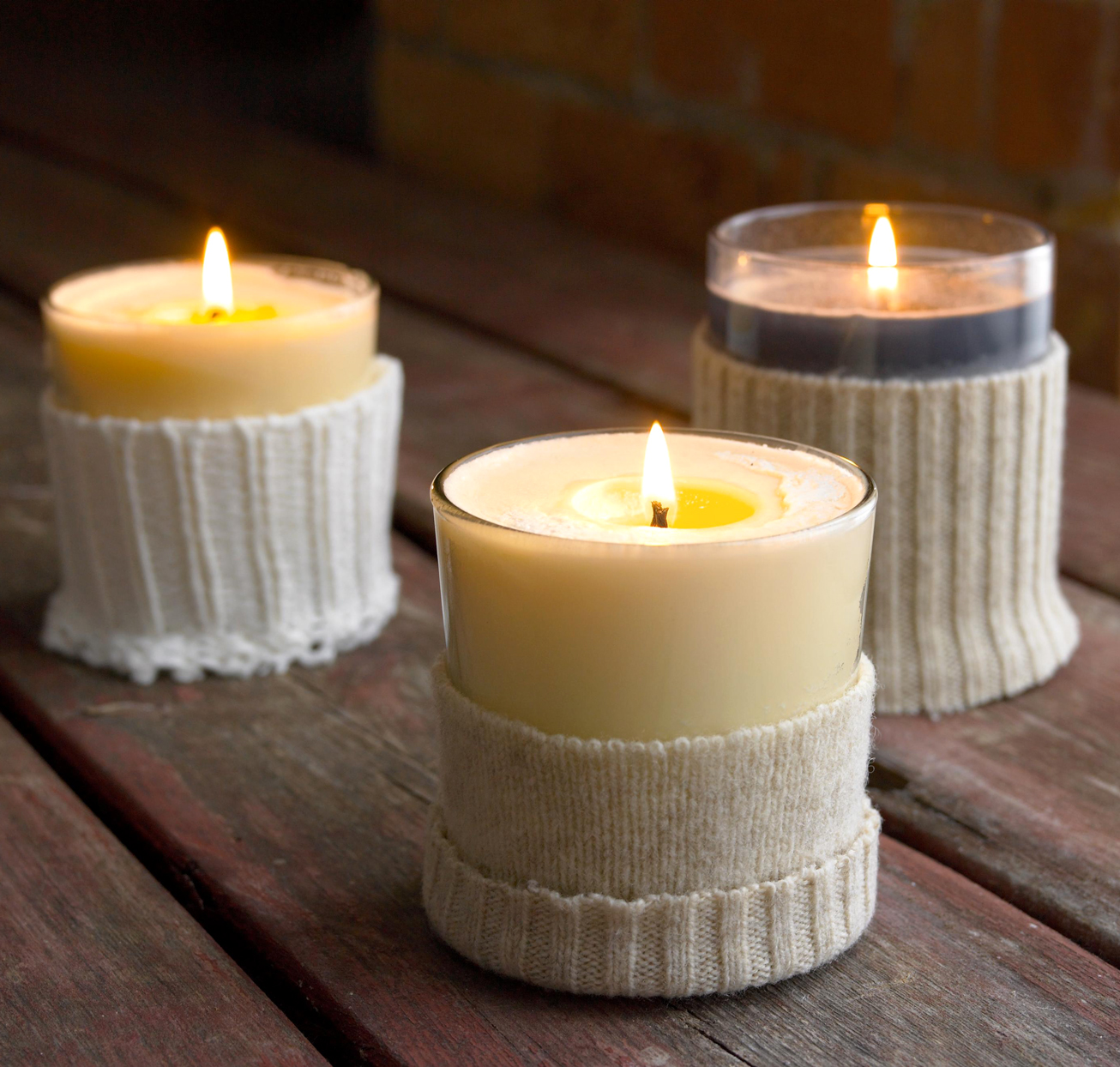 candles with sweaters