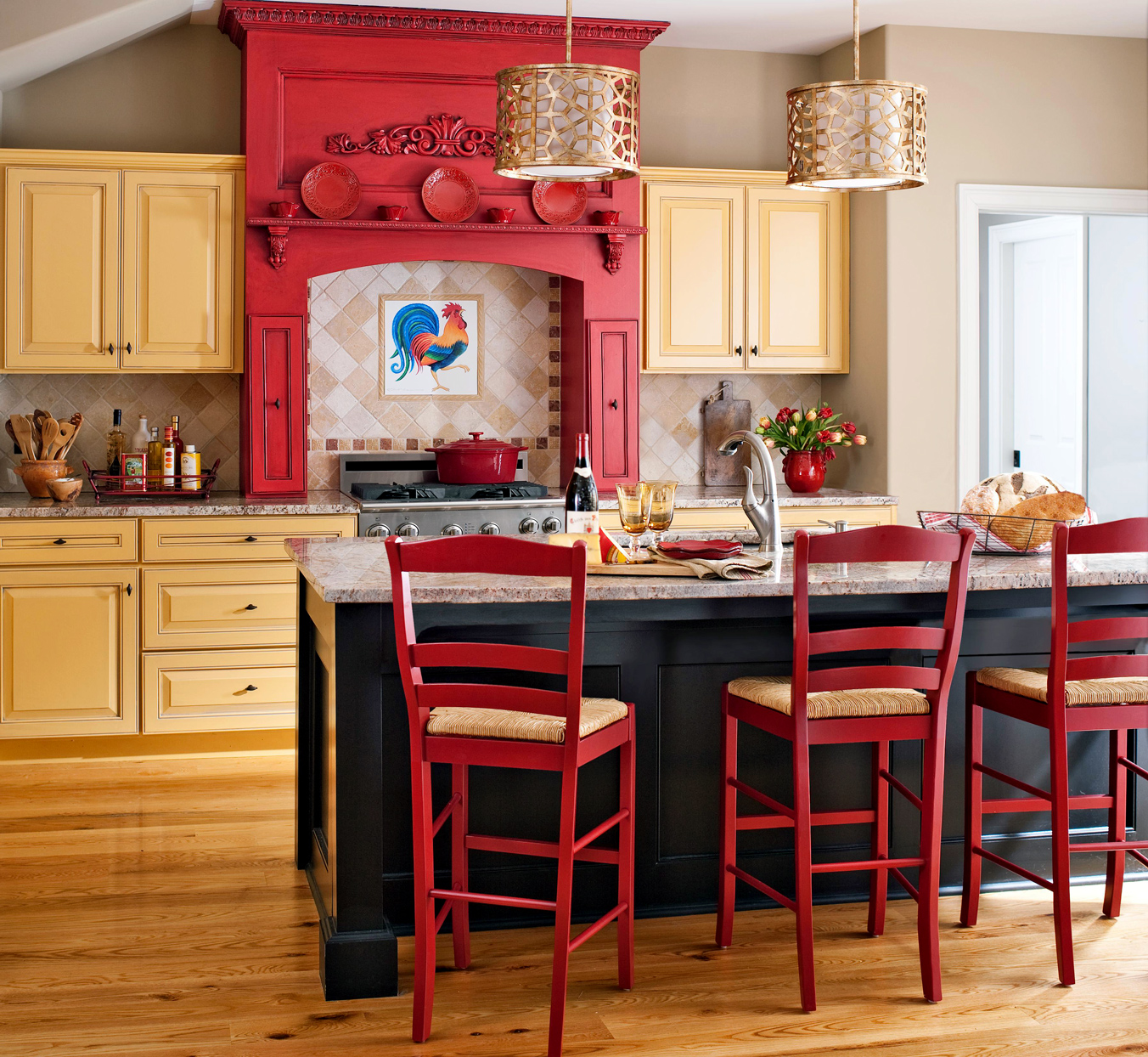 red and yellow kitchen with pendant lights