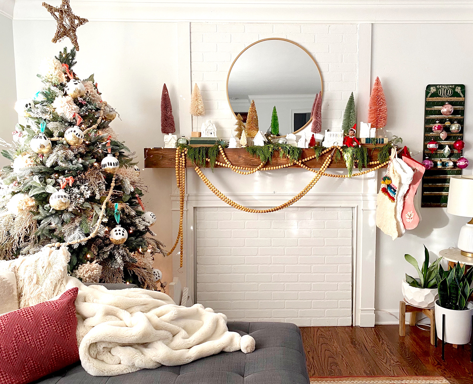 mantel and christmas tree decorated with colorful boho decor