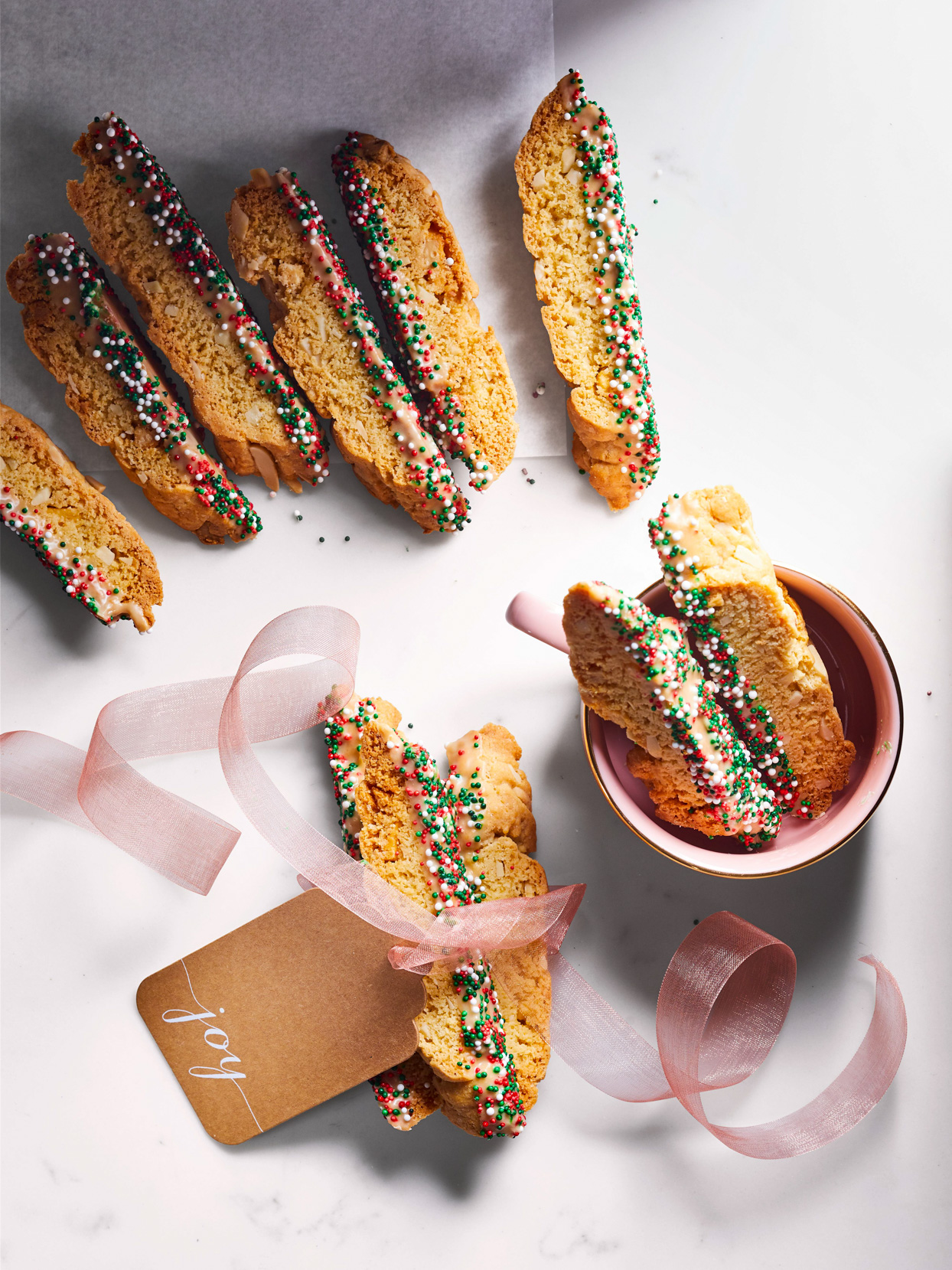 Almond Irish Cream Biscotti arranged with ribbon and a cup