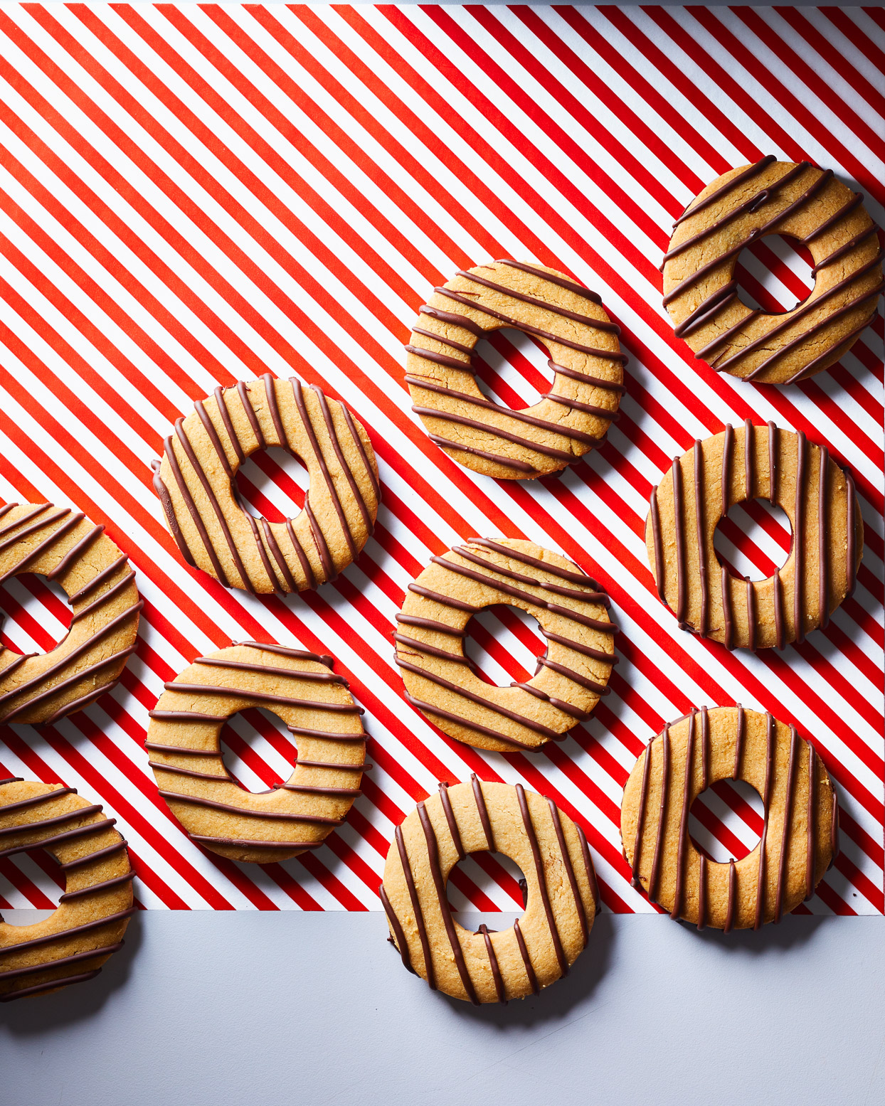 Fudgy Striped Peanut Butter Shortbread on red and white background