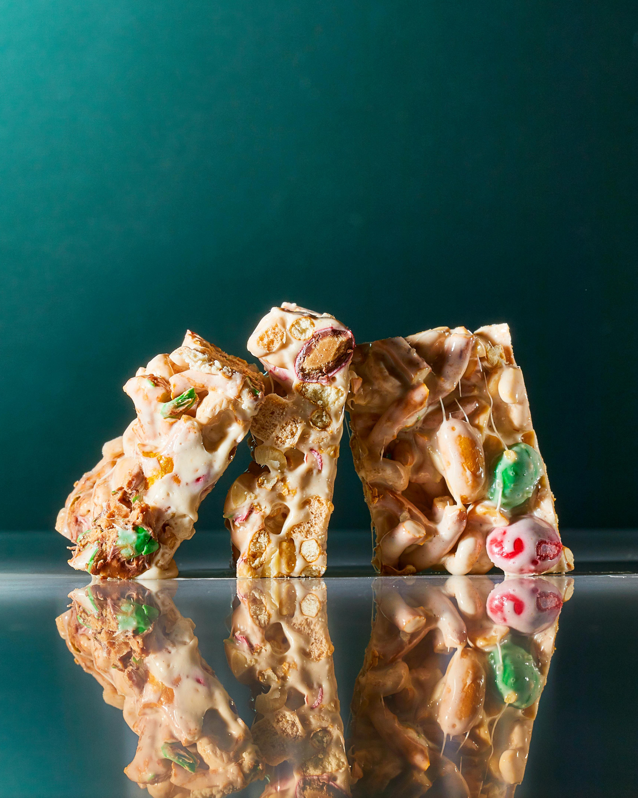 three Marshmallow-Pretzel Bars on green background