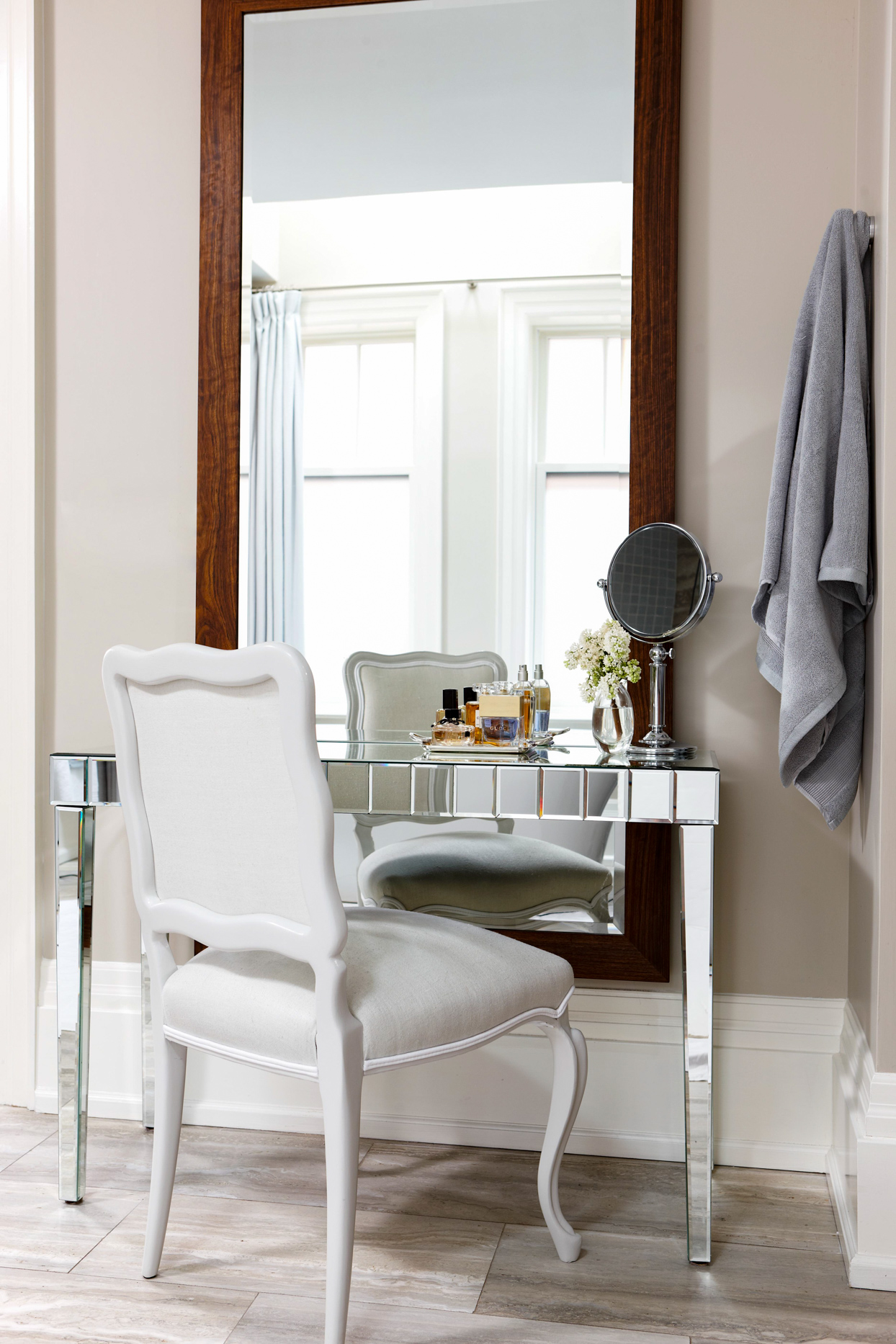 vanity table with white chair and floor length mirror