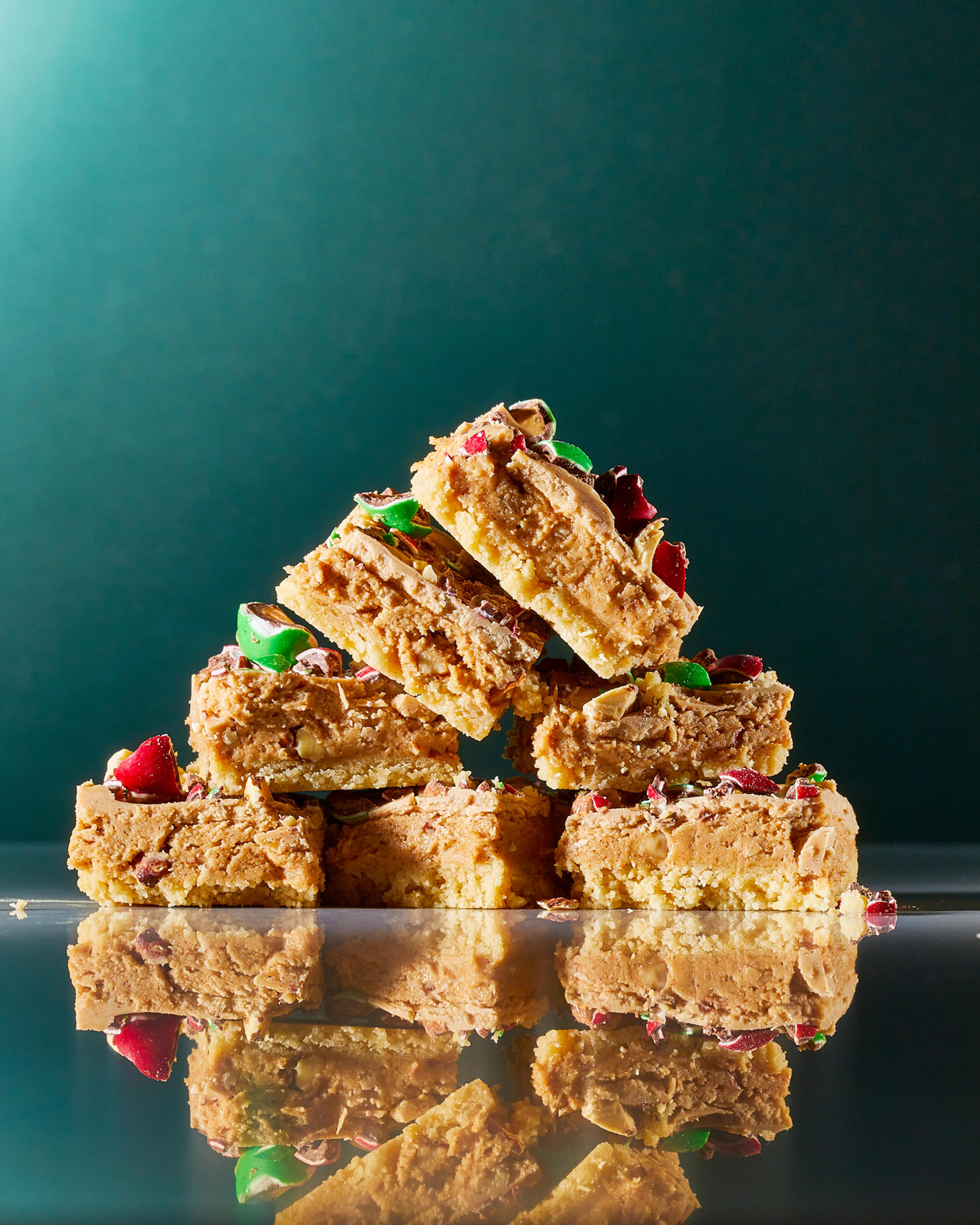 Almond Crunch Bars stacked on green background