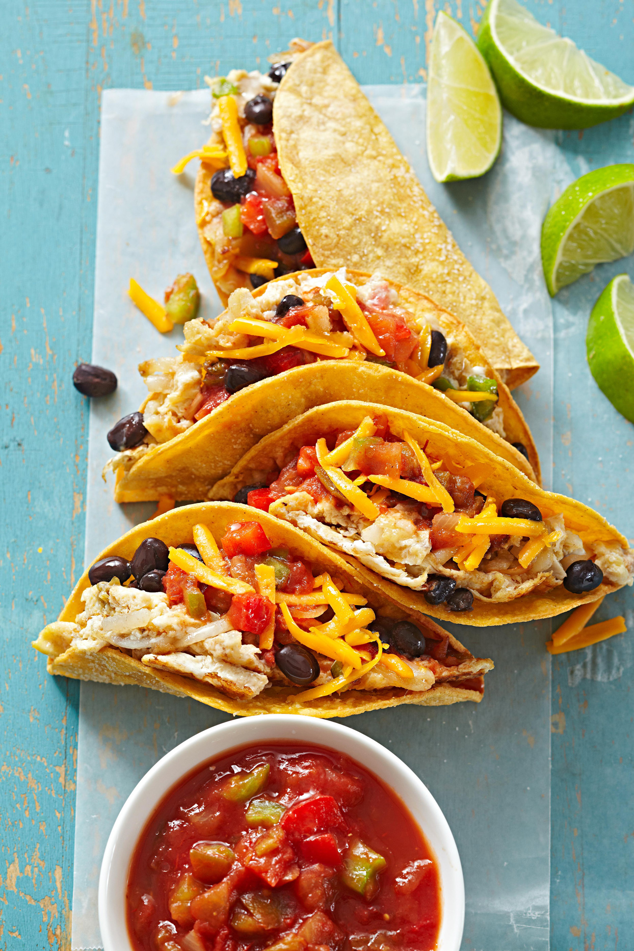 Hearty Breakfast Tacos with salsa and limes