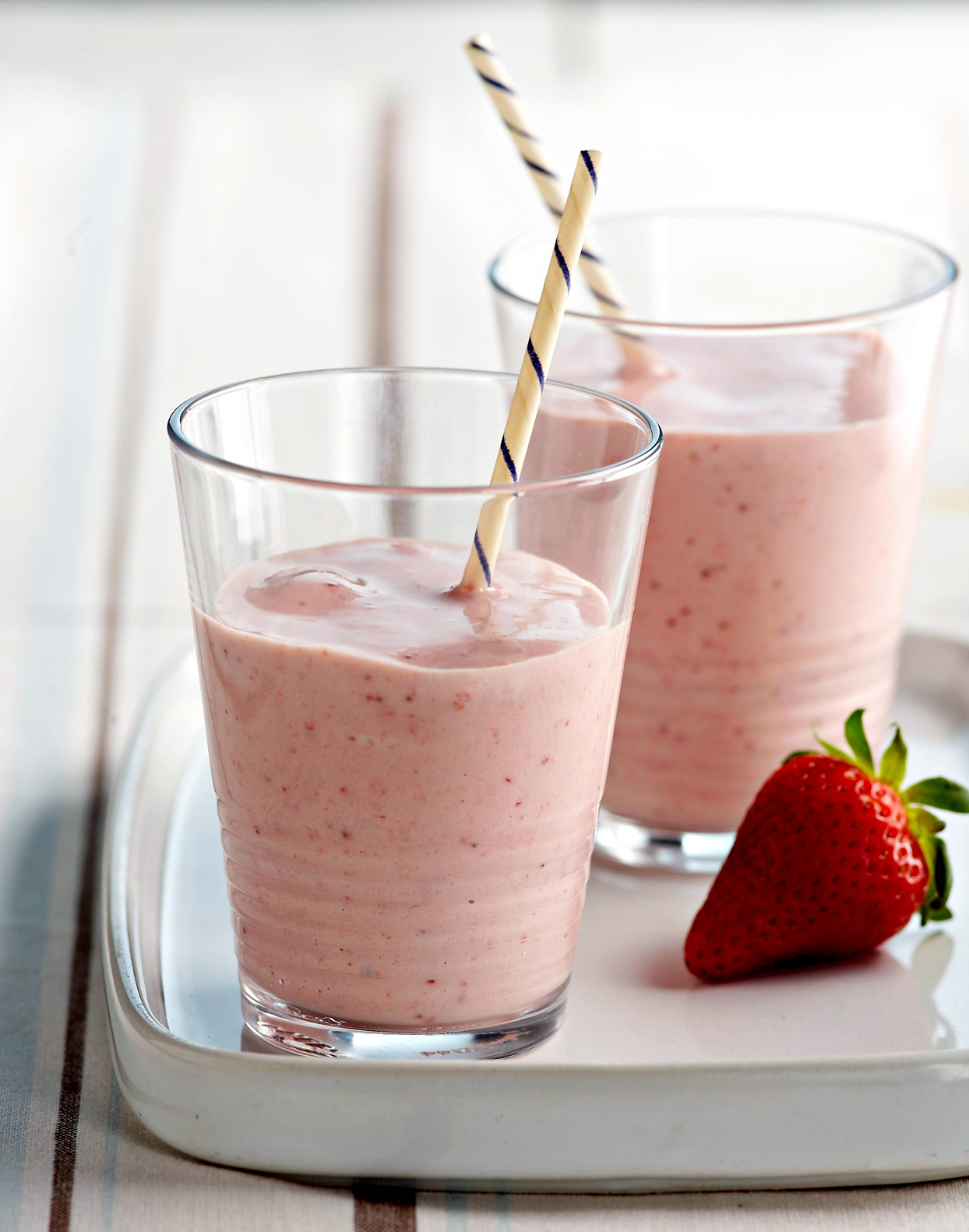 Protein-Packed strawberry Smoothies with straws