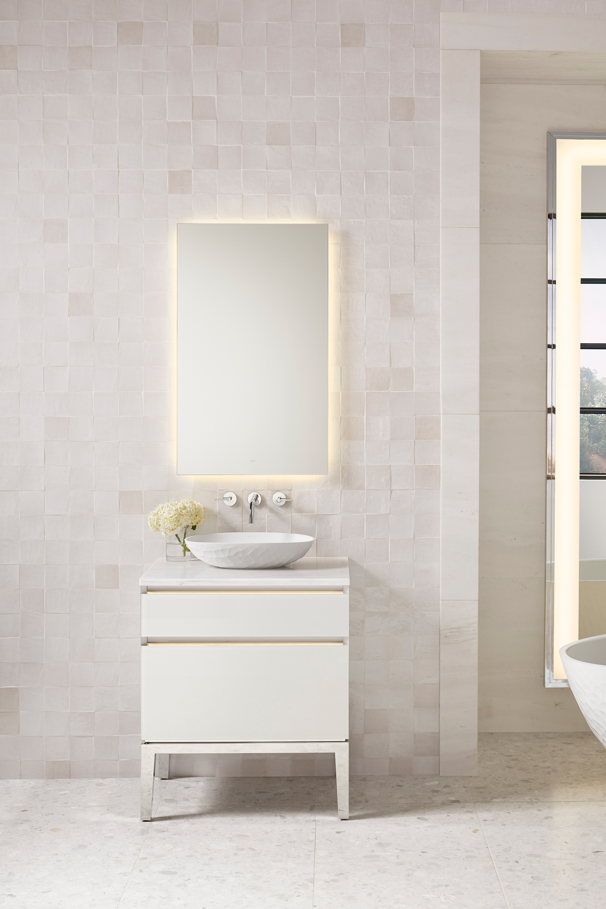 white tiled bathroom with backlit mirror