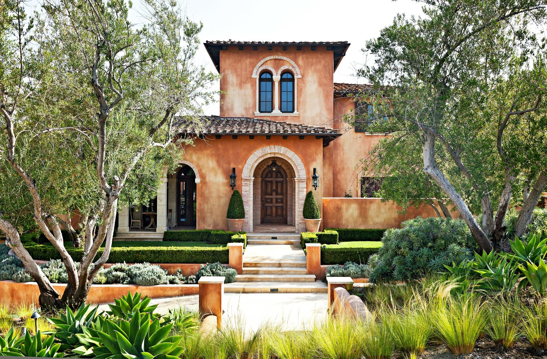 16 Mediterranean Style Homes With Global Inspired Beauty Better Homes Gardens
