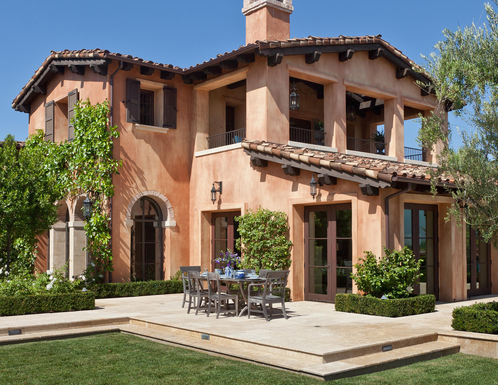 Mediterranean-inspired home with patio