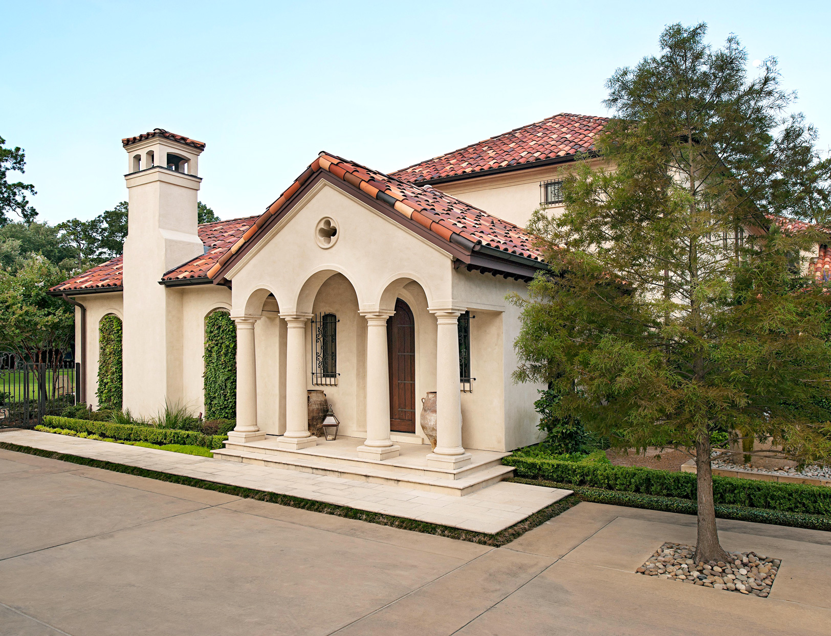 Mediterranean-inspired home with stone columns