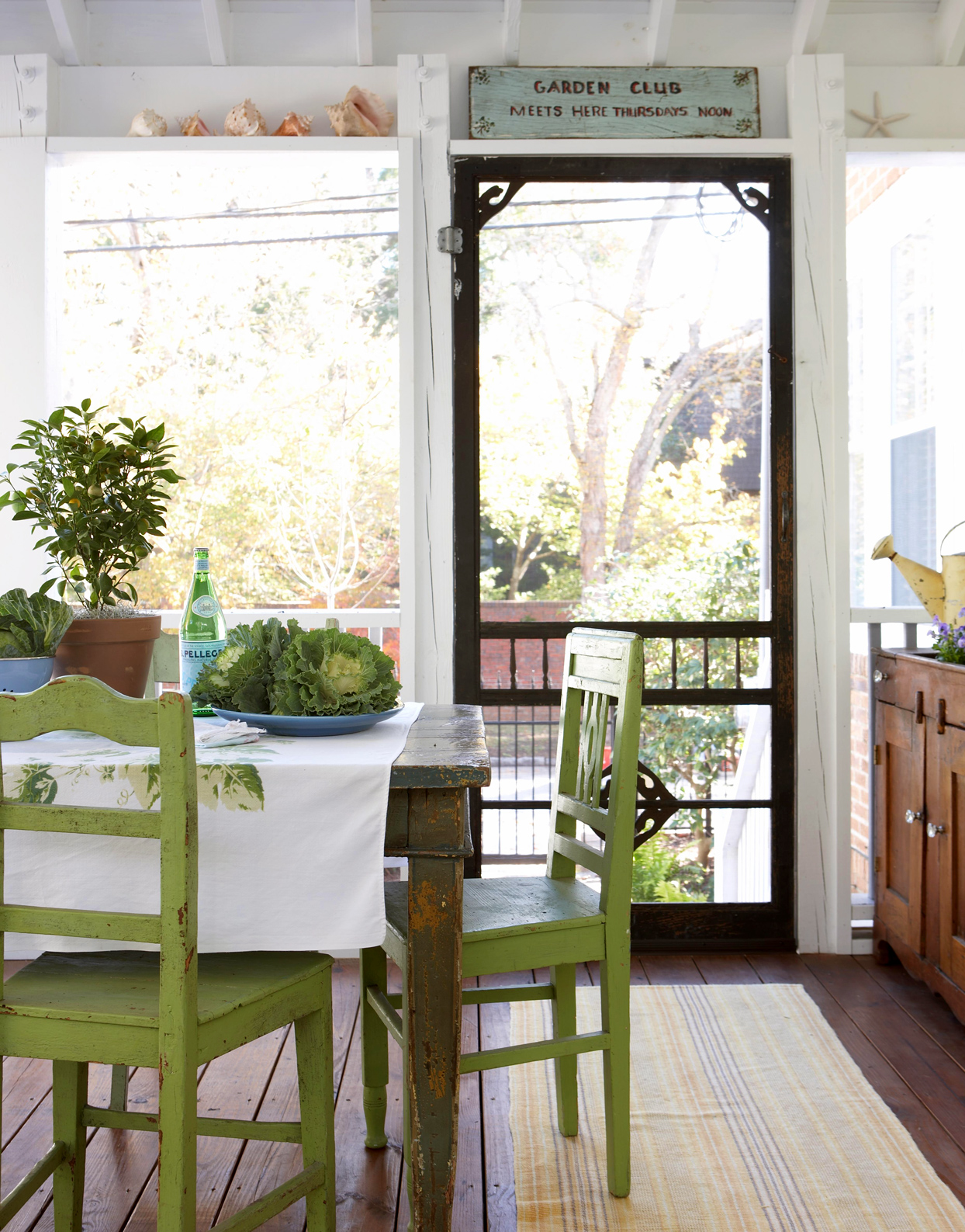 screened porch with lime green dining set