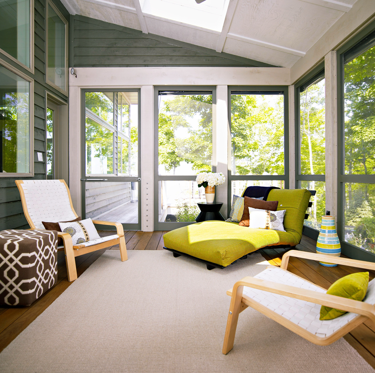 screened porch with lounge chairs