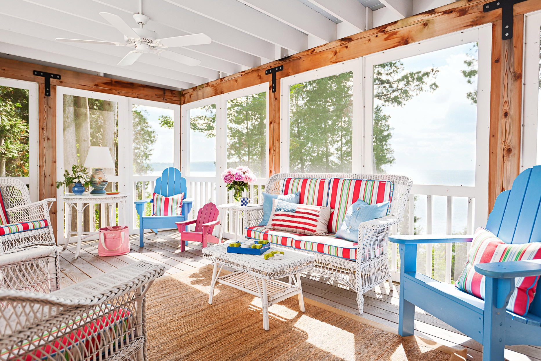 screened porch with red, white, and blue furniture