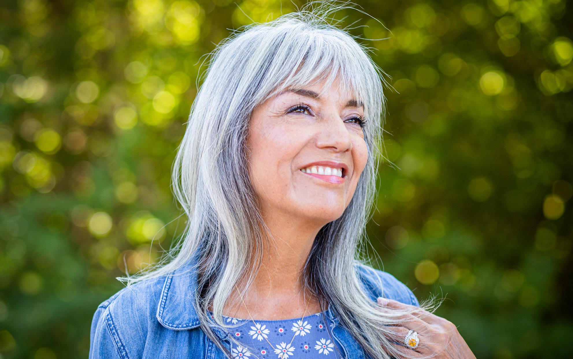 Woman with long, grey hair outside