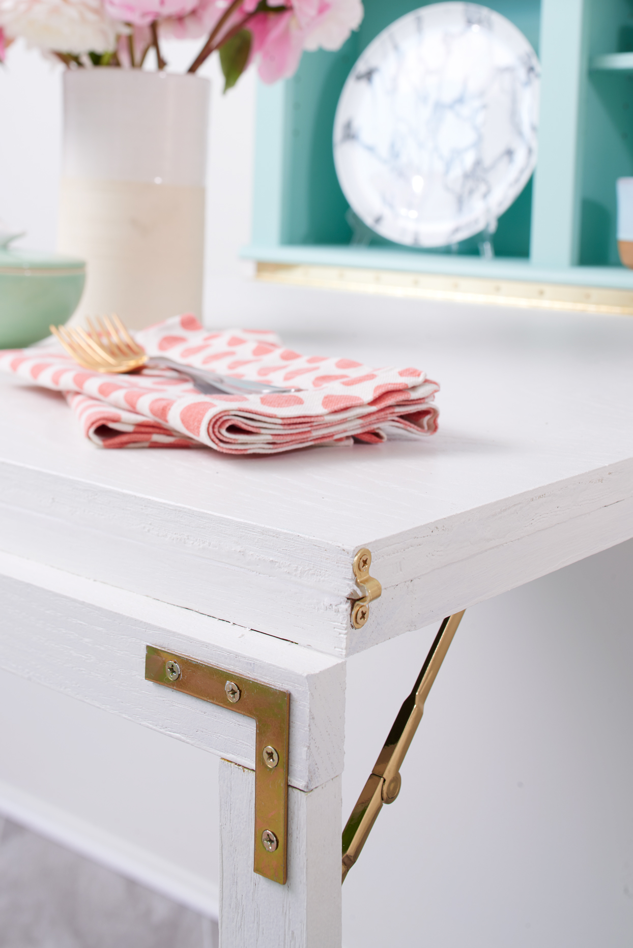 White table with gold hardware