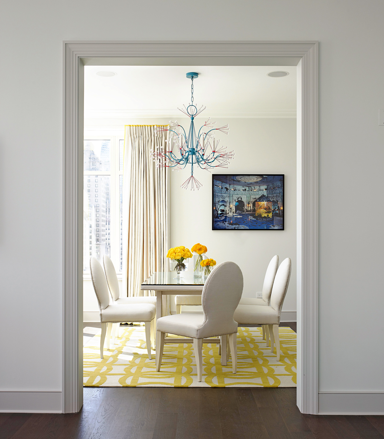 dining room with yellow rug