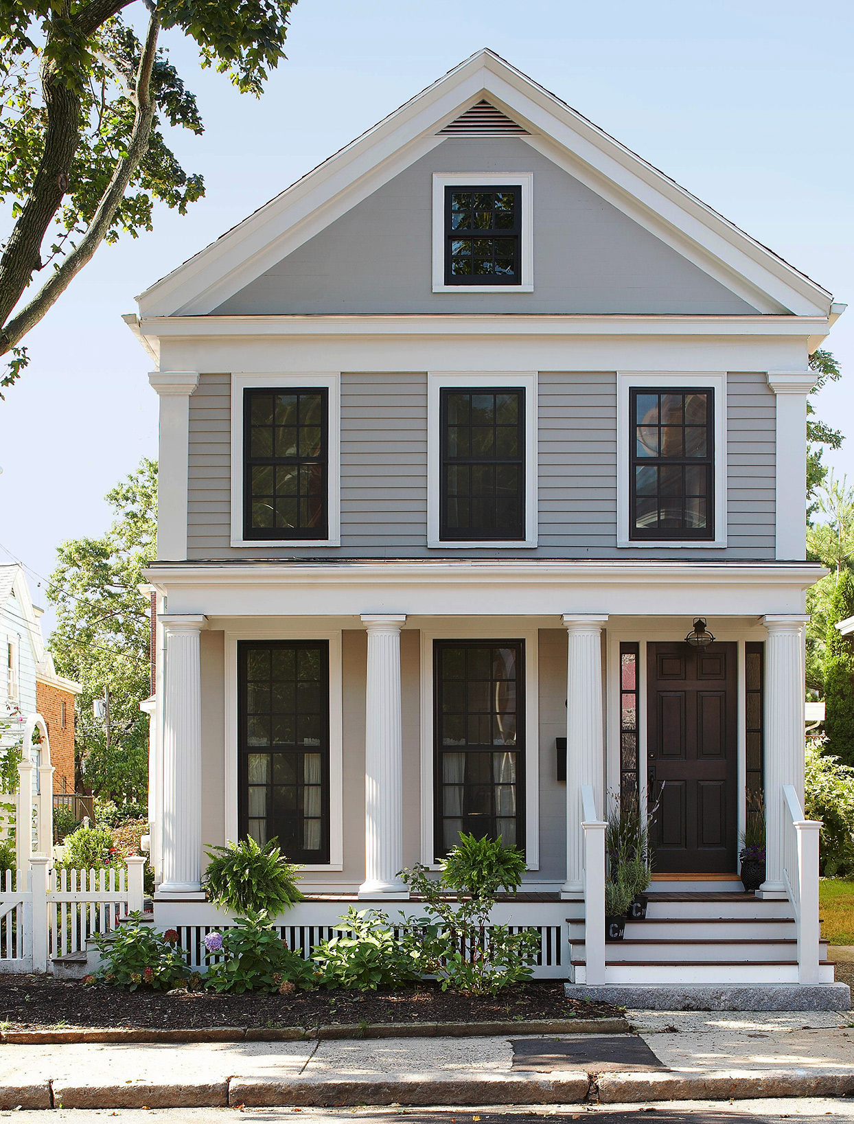gray symmetrical colonial style home