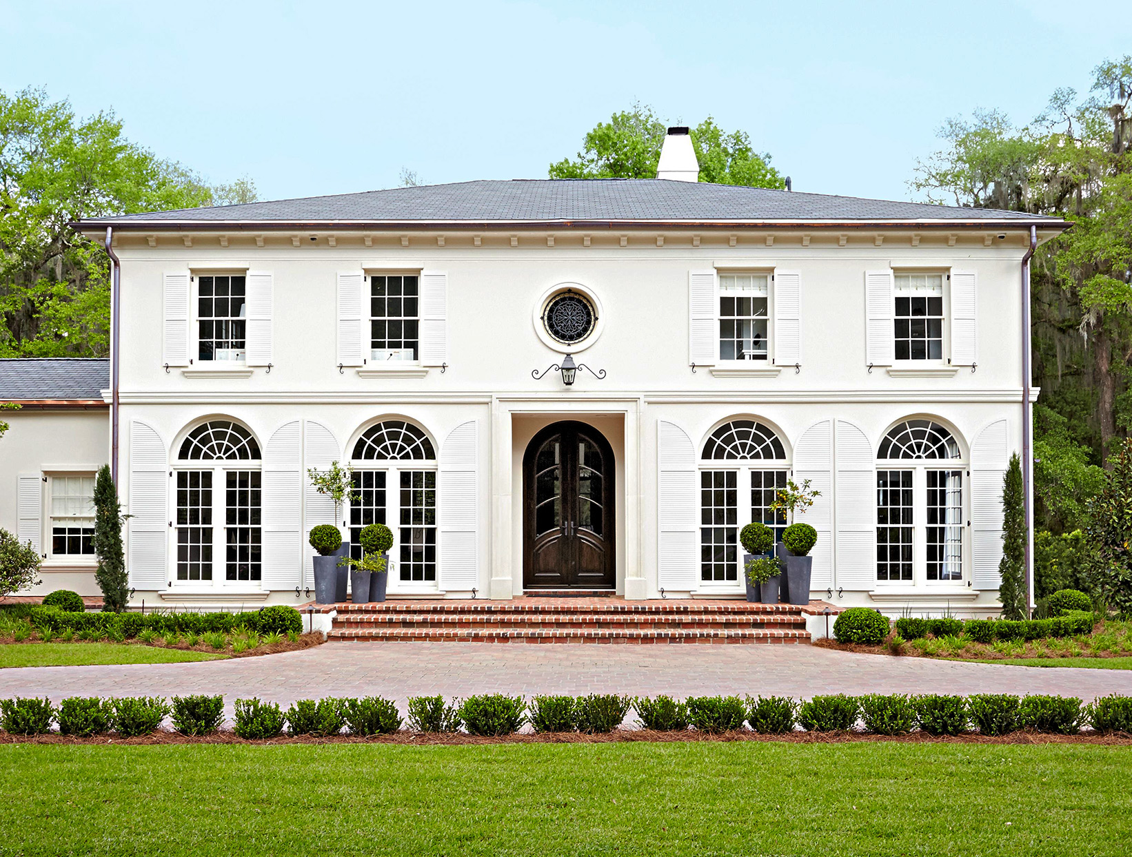 large windows white colonial style home