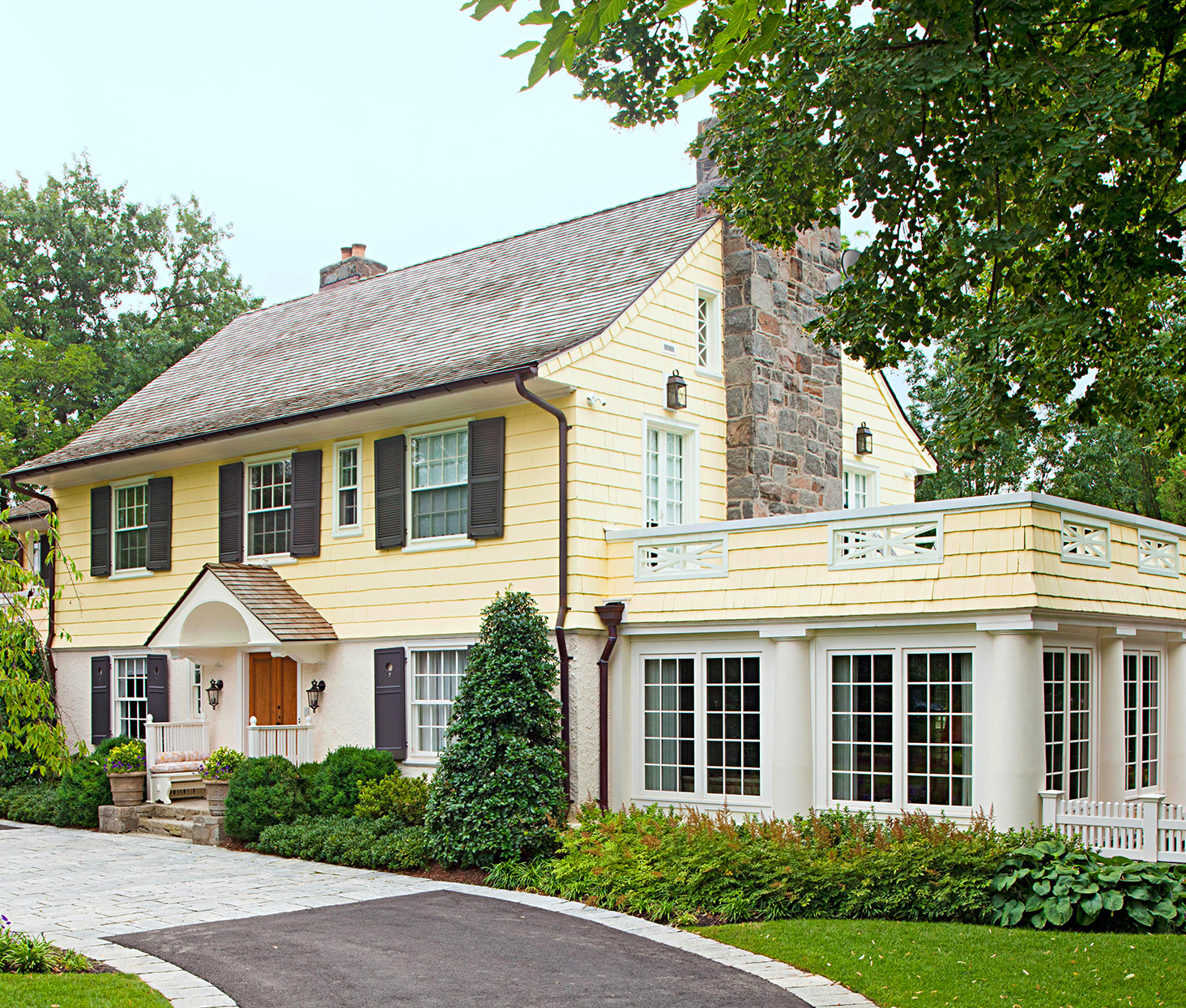 yellow and white colonial style home