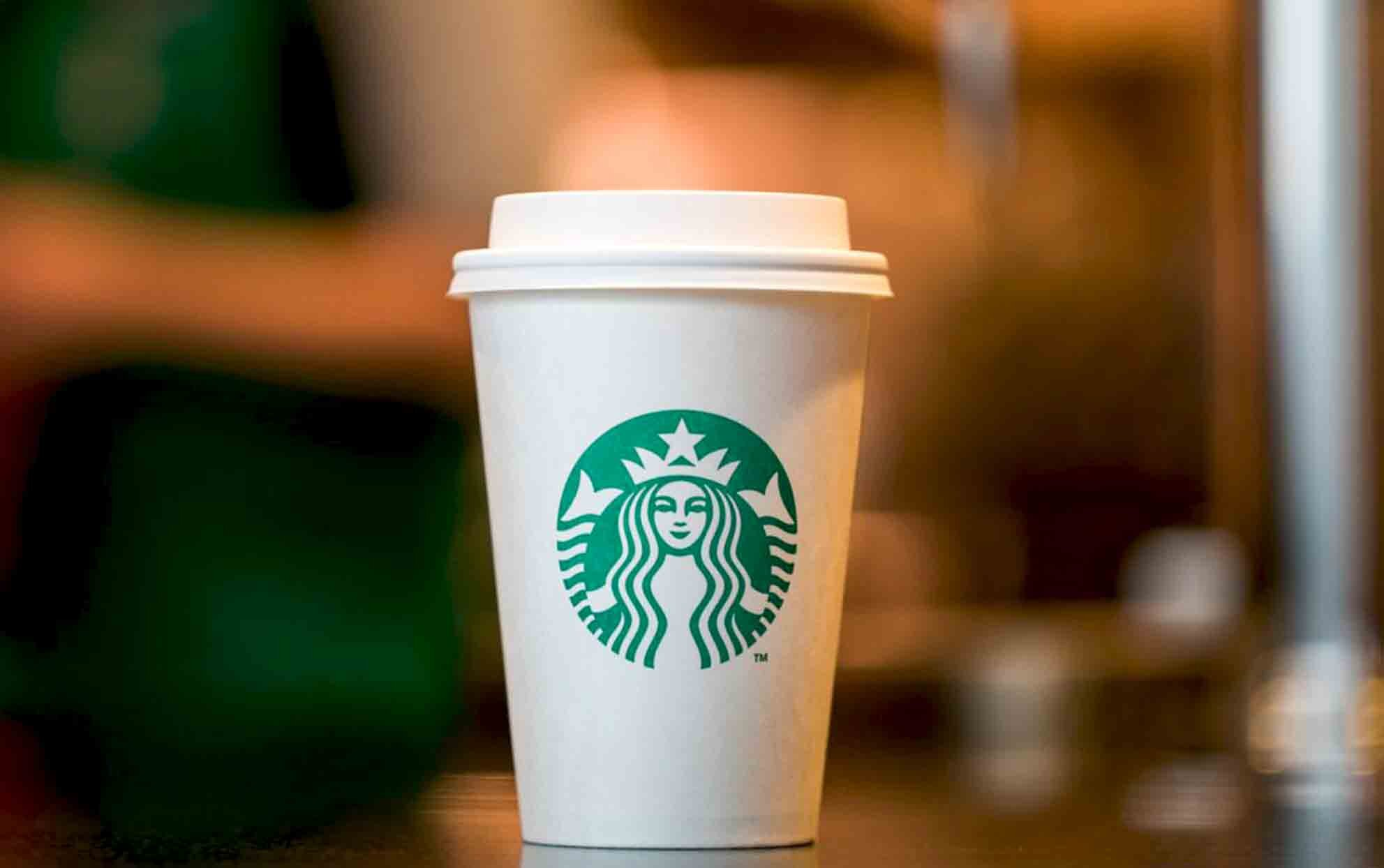 Starbucks white to go cup in a Starbucks store