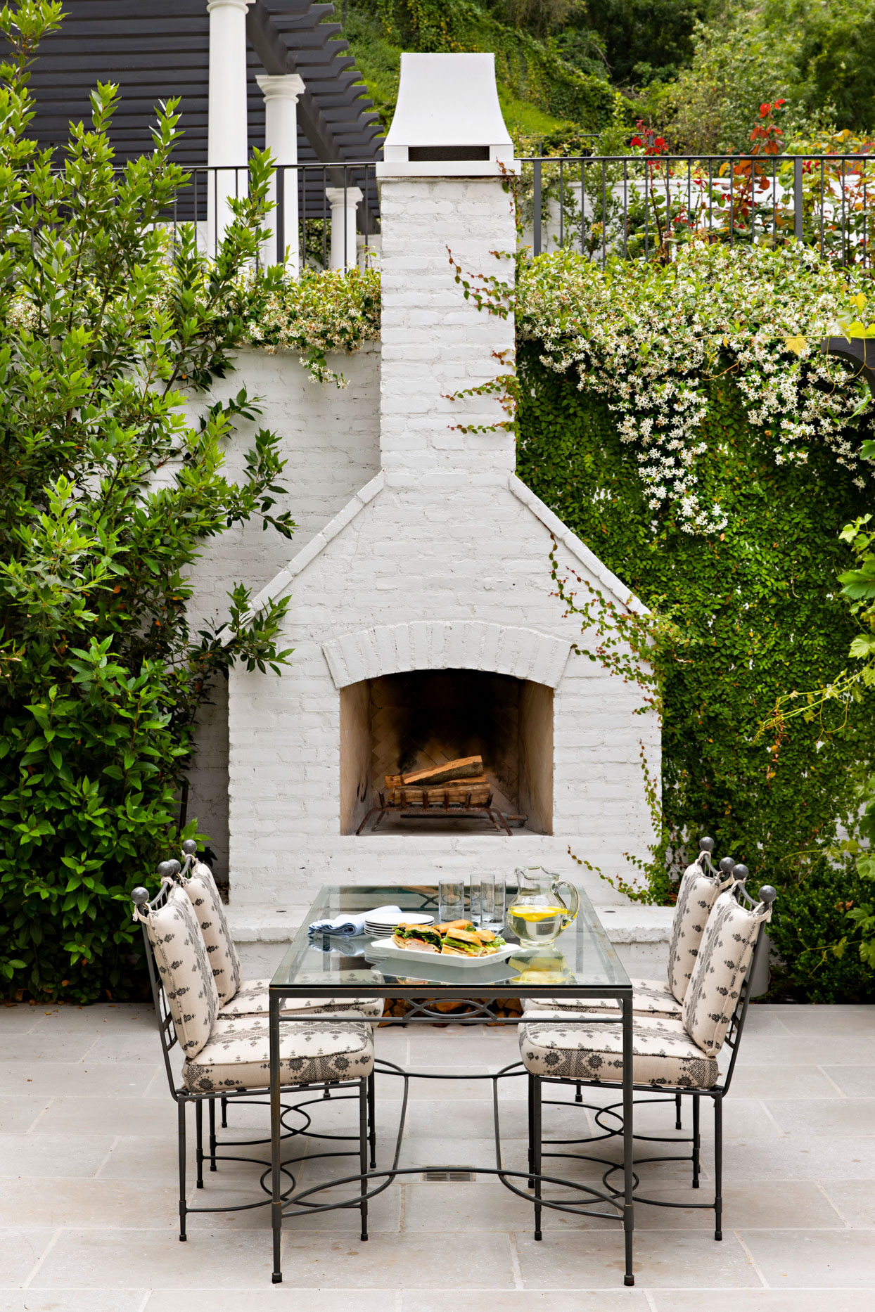 outdoor patio with white brick fireplace and chimney