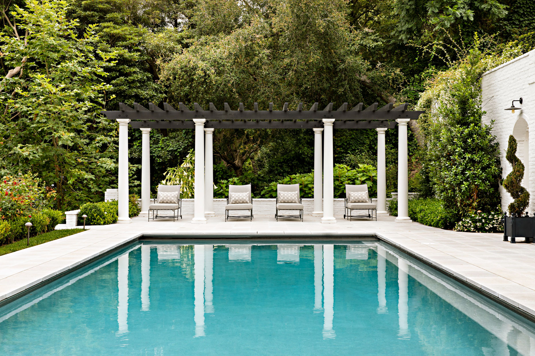outdoor pool with modern pagoda and greenery background