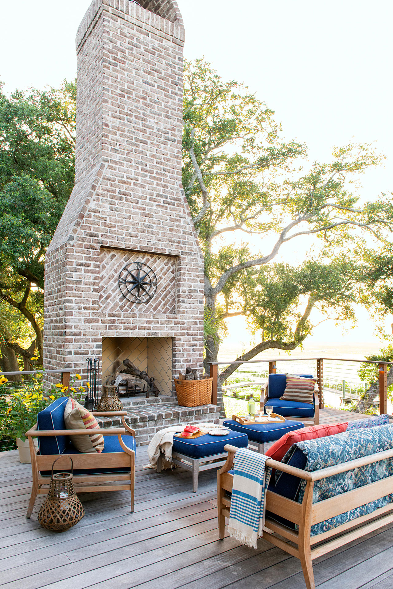 patio with large brick fireplace