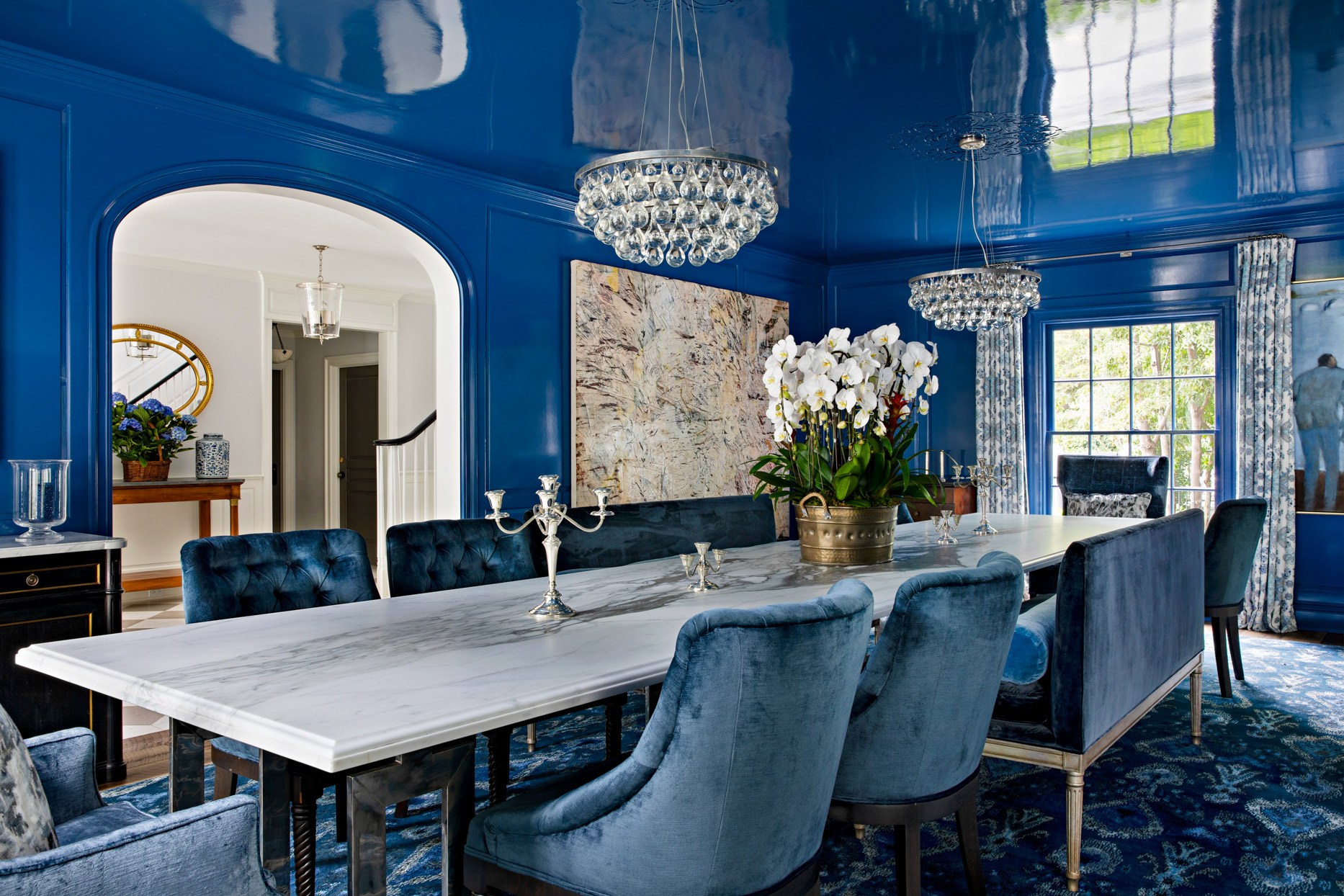 royal blue elegant dining room with velvet chairs