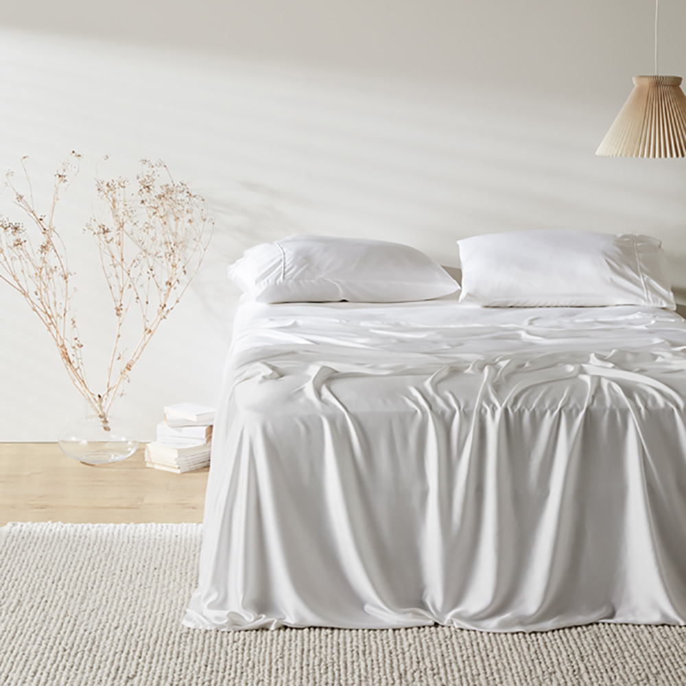minimalist bedroom with white bamboo bed sheets