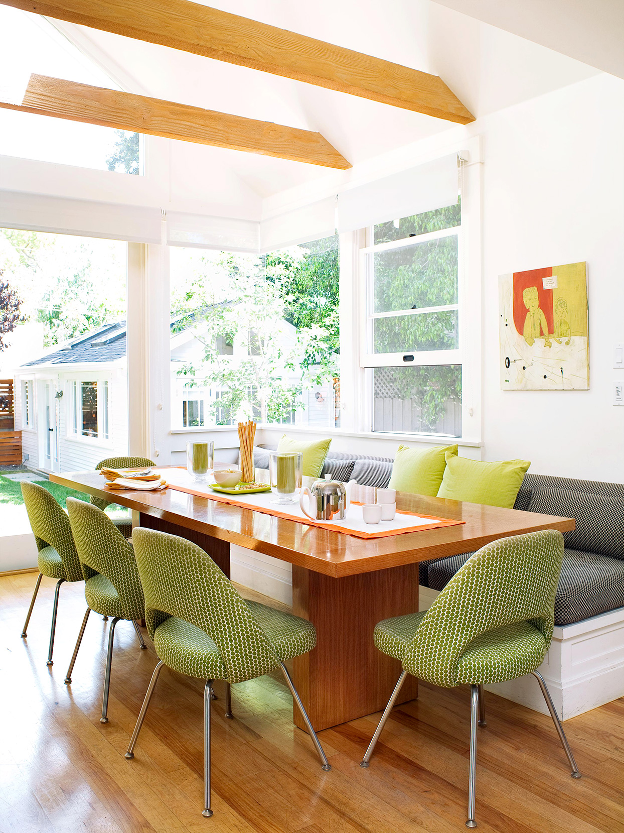 dining area with wooden table and green chairs
