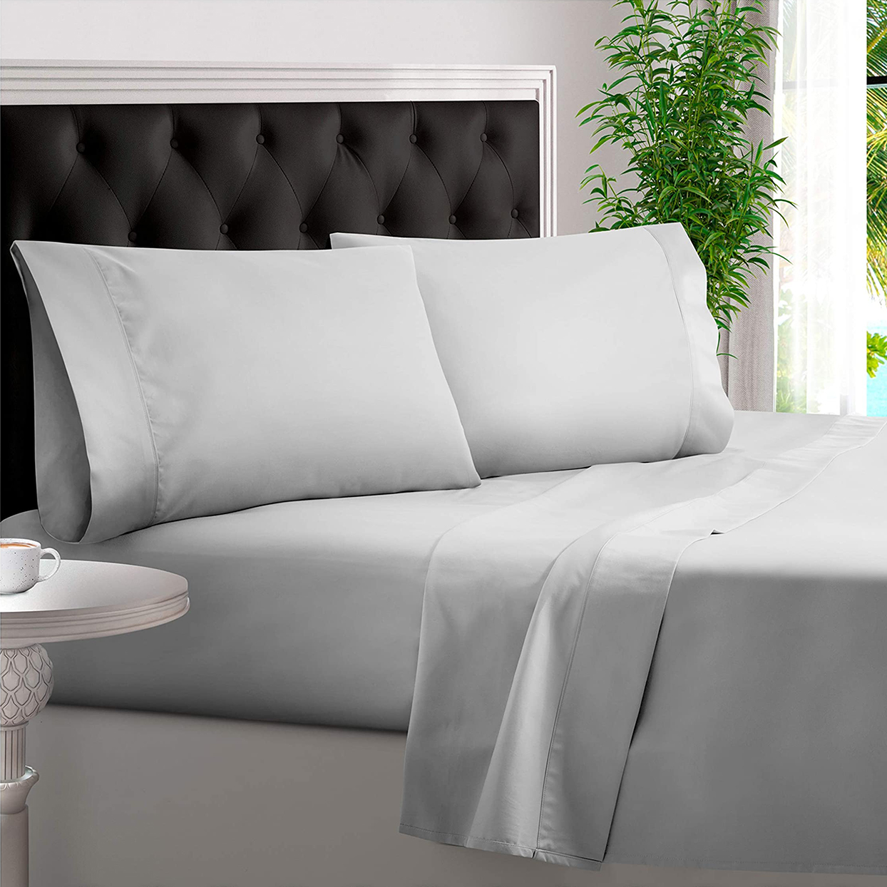 bed covered in light gray bamboo sheets