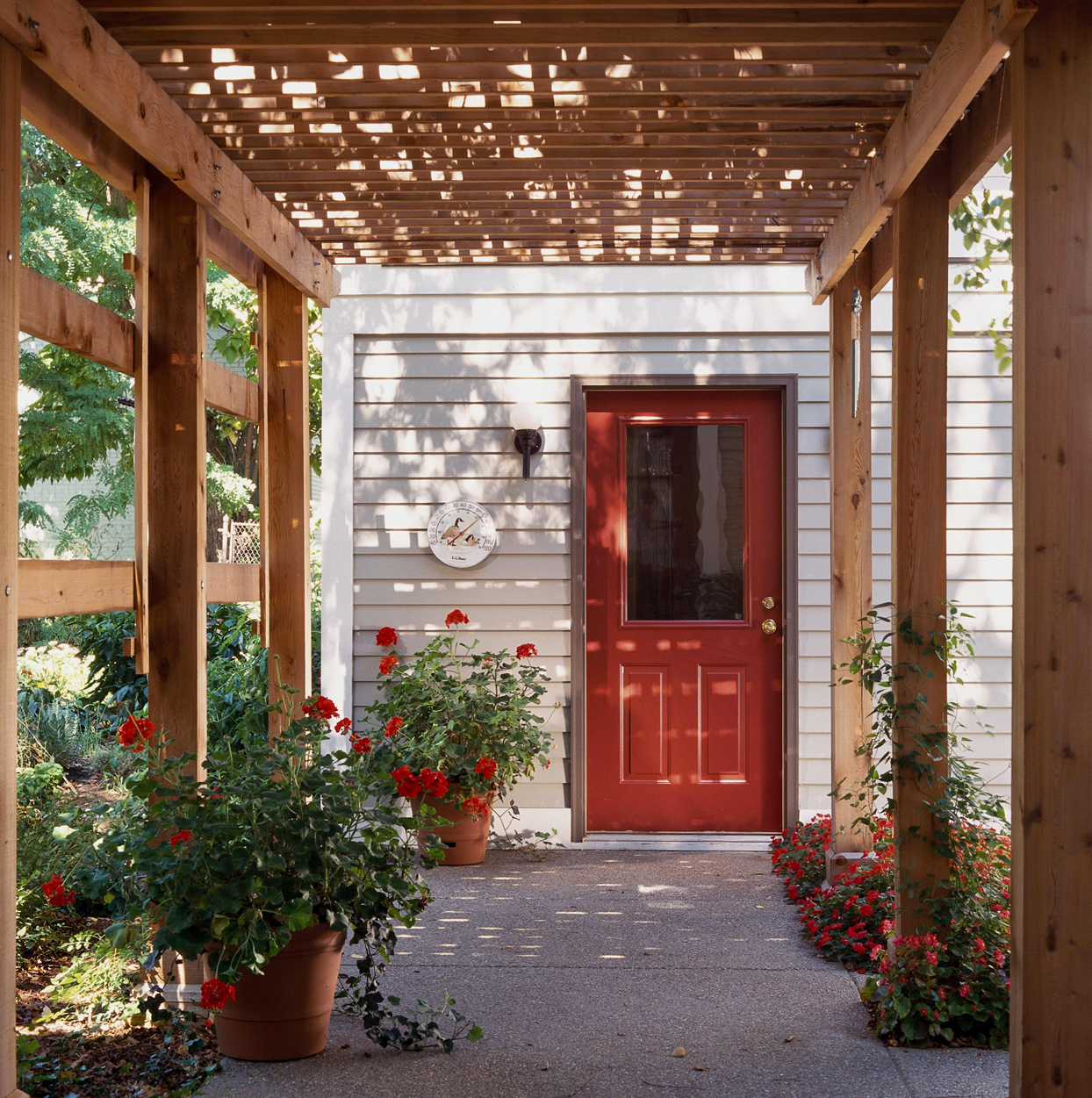 Wood Pergola Red Door with Red Flowers