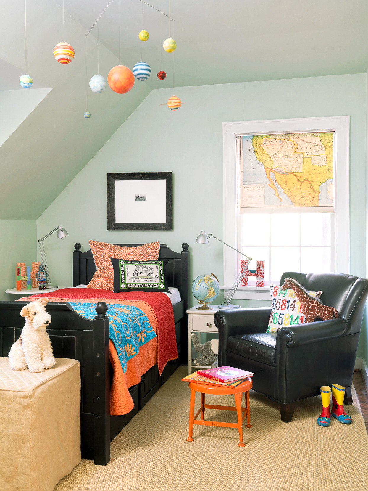 childrens bedroom with planets and stuffed animals